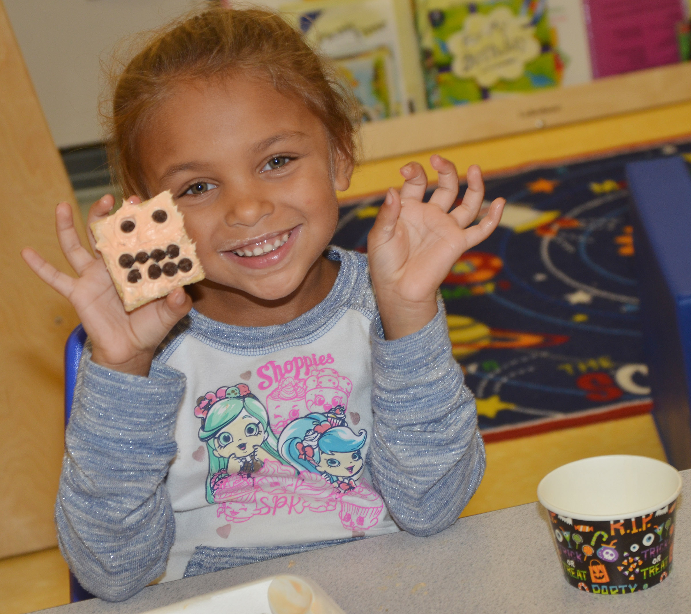 CES preschool student Adaia Taylor holds her monster cookie.