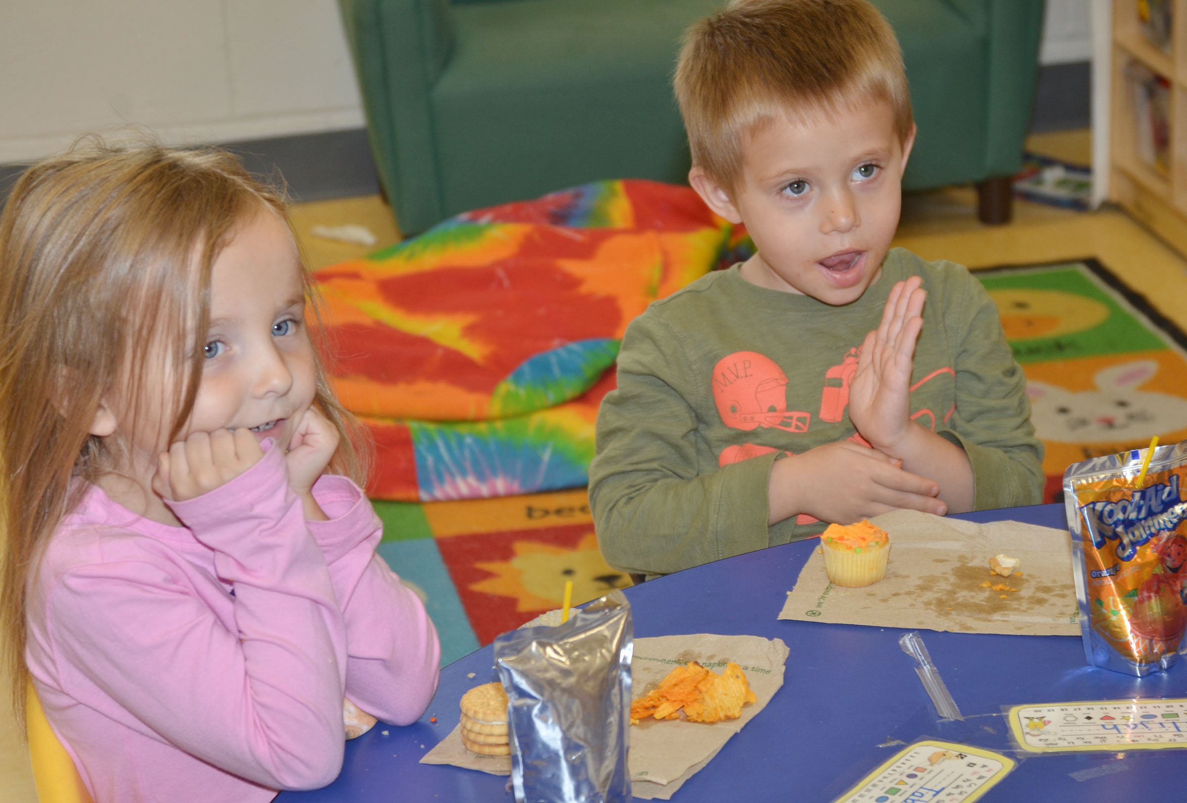CES preschool students Tabitha Leggett, at left, and Elijah Russell enjoy their party.