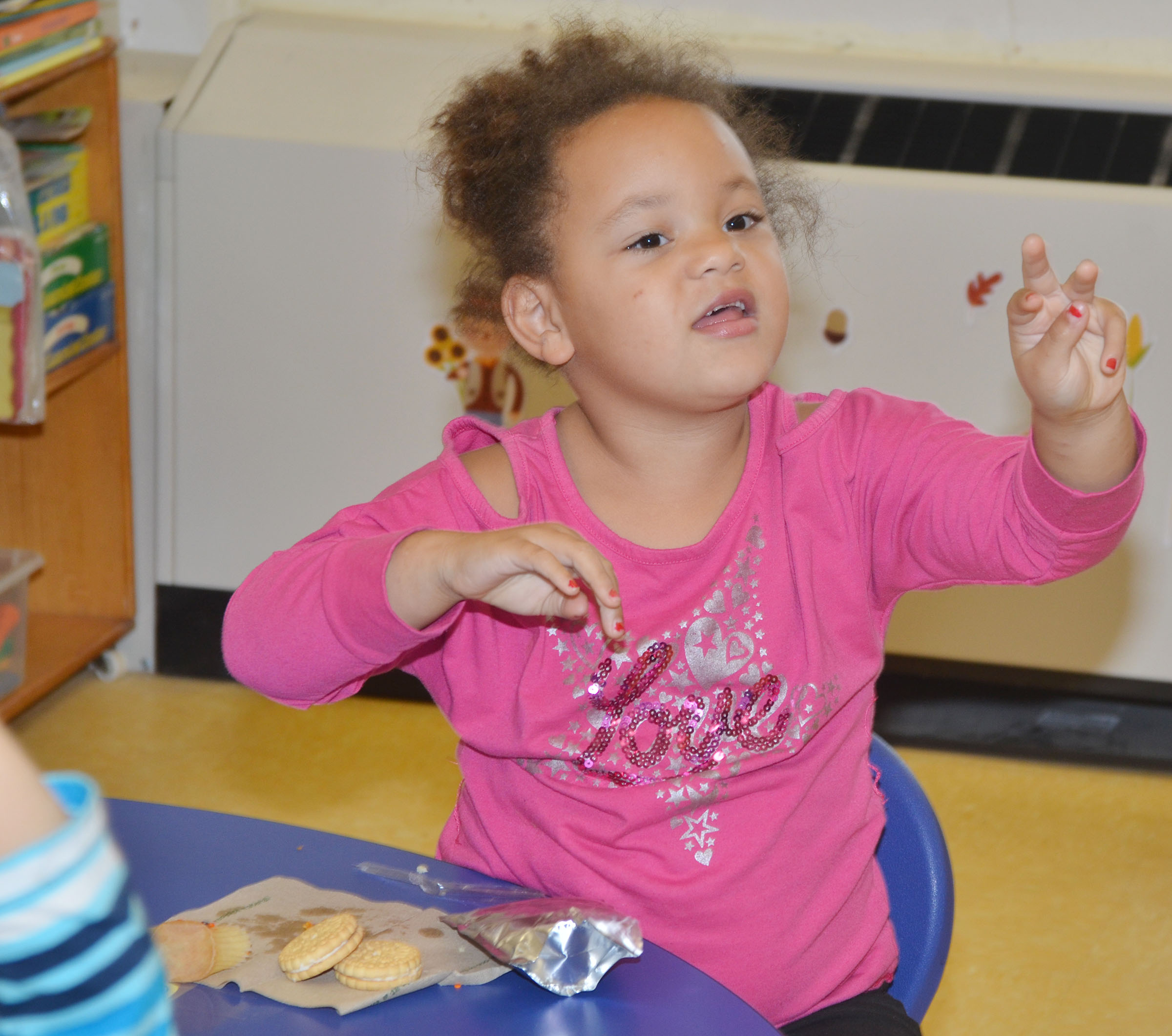 CES preschool student Lillian Merriweather sings a song.