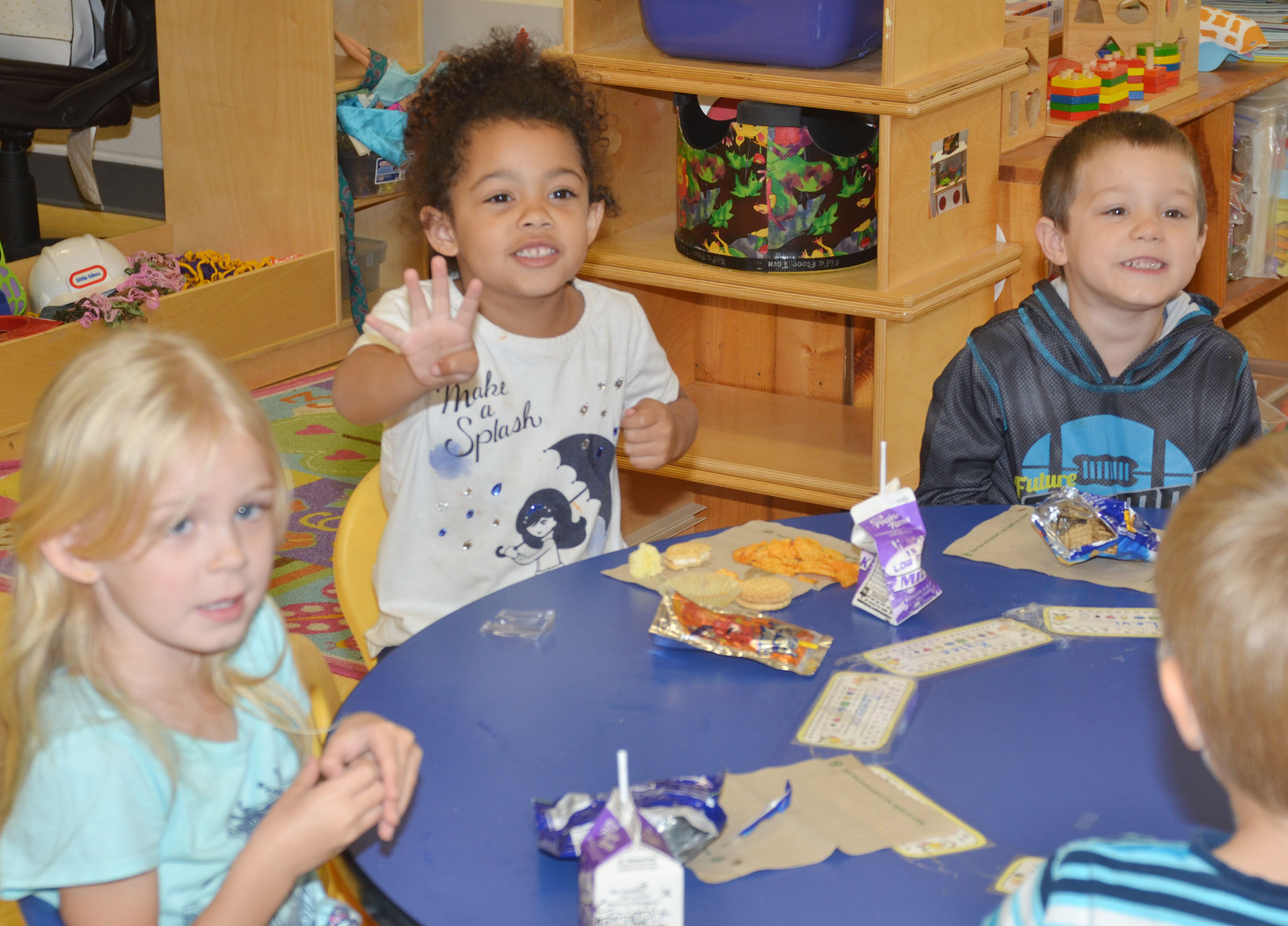 From left, CES preschool students Alinna Bray, Rylee Karr and Levi Ritchie have fun at their party.