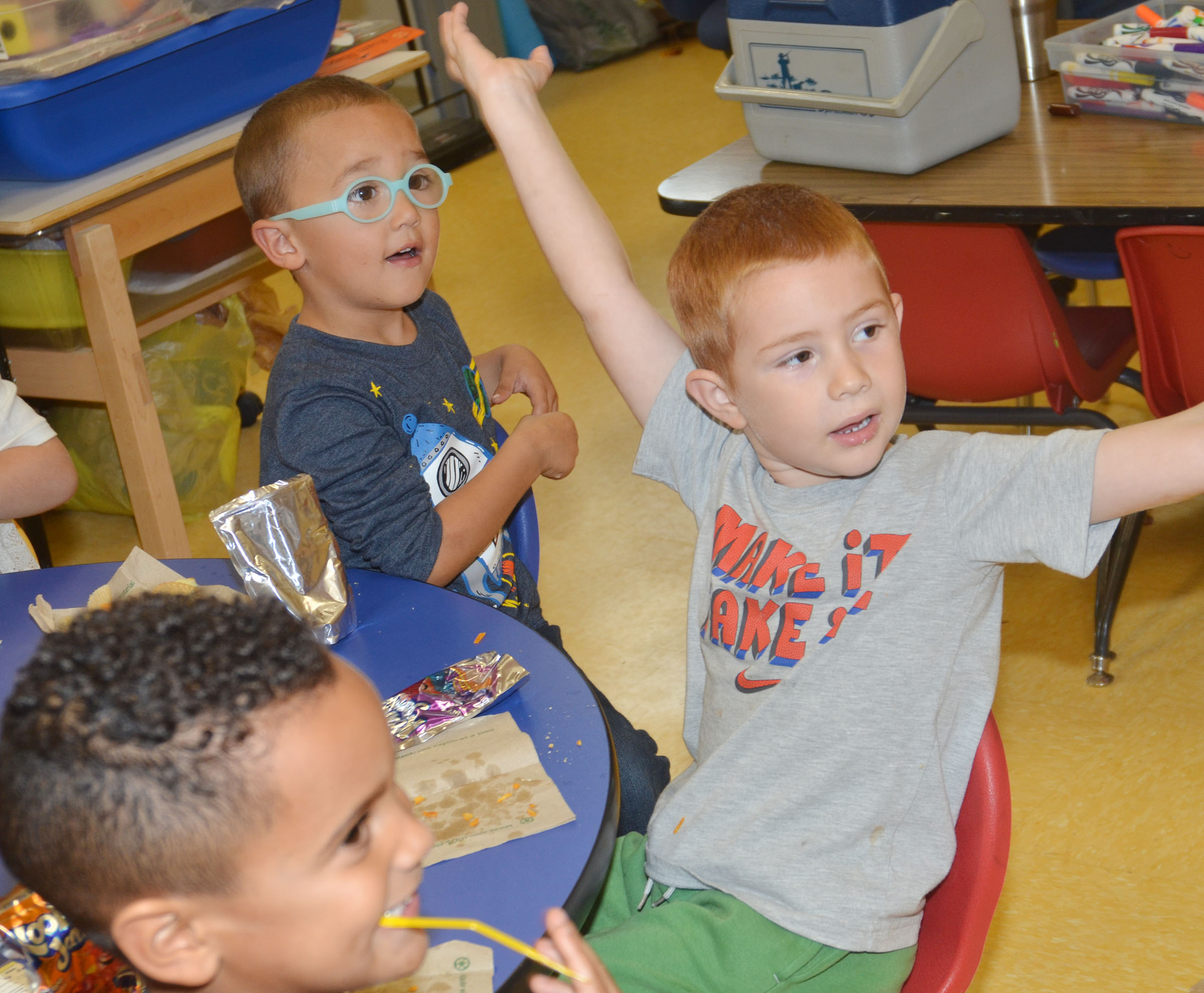 From left, CES preschool students Kingston Cowherd, Chanler Mann and Kennon Dotson have fun at their party.