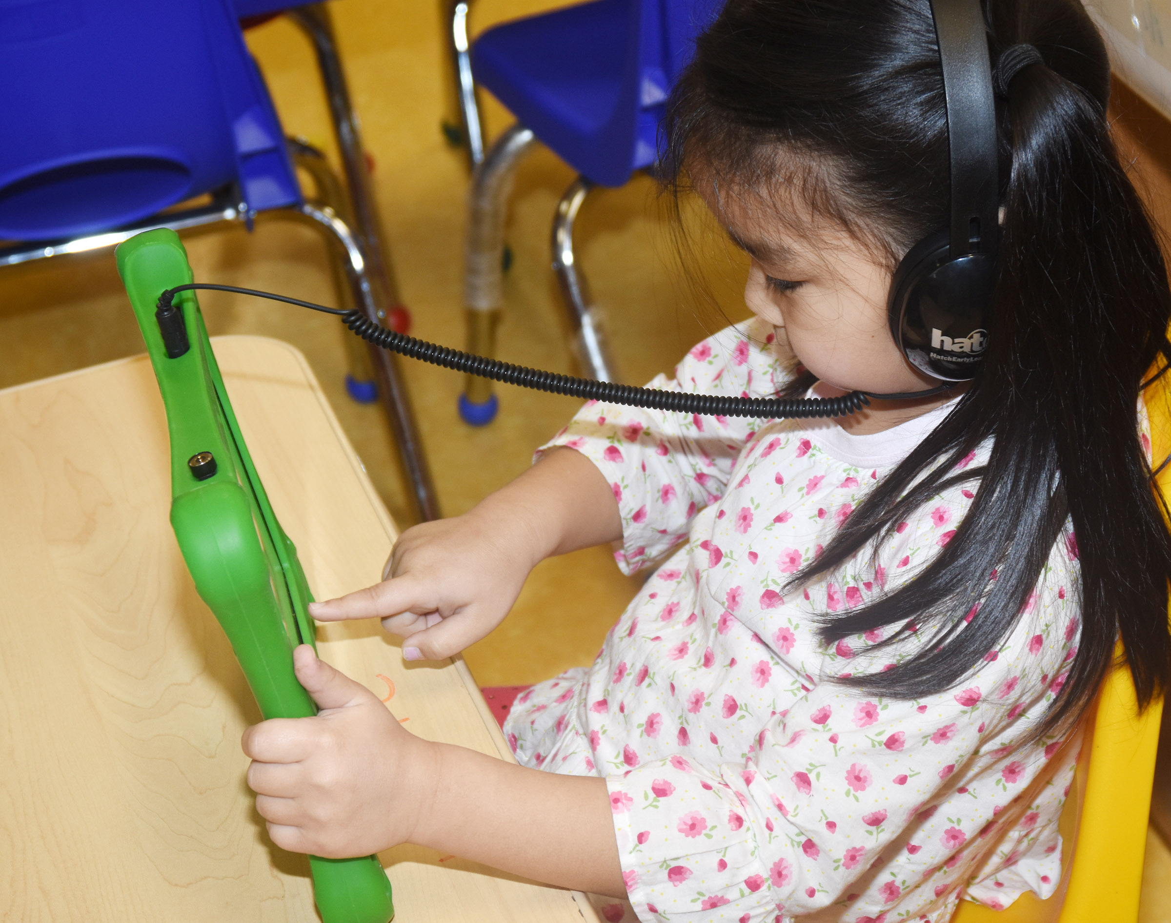 CES preschool student Marla Bat plays a game on her iStartSmart tablet.