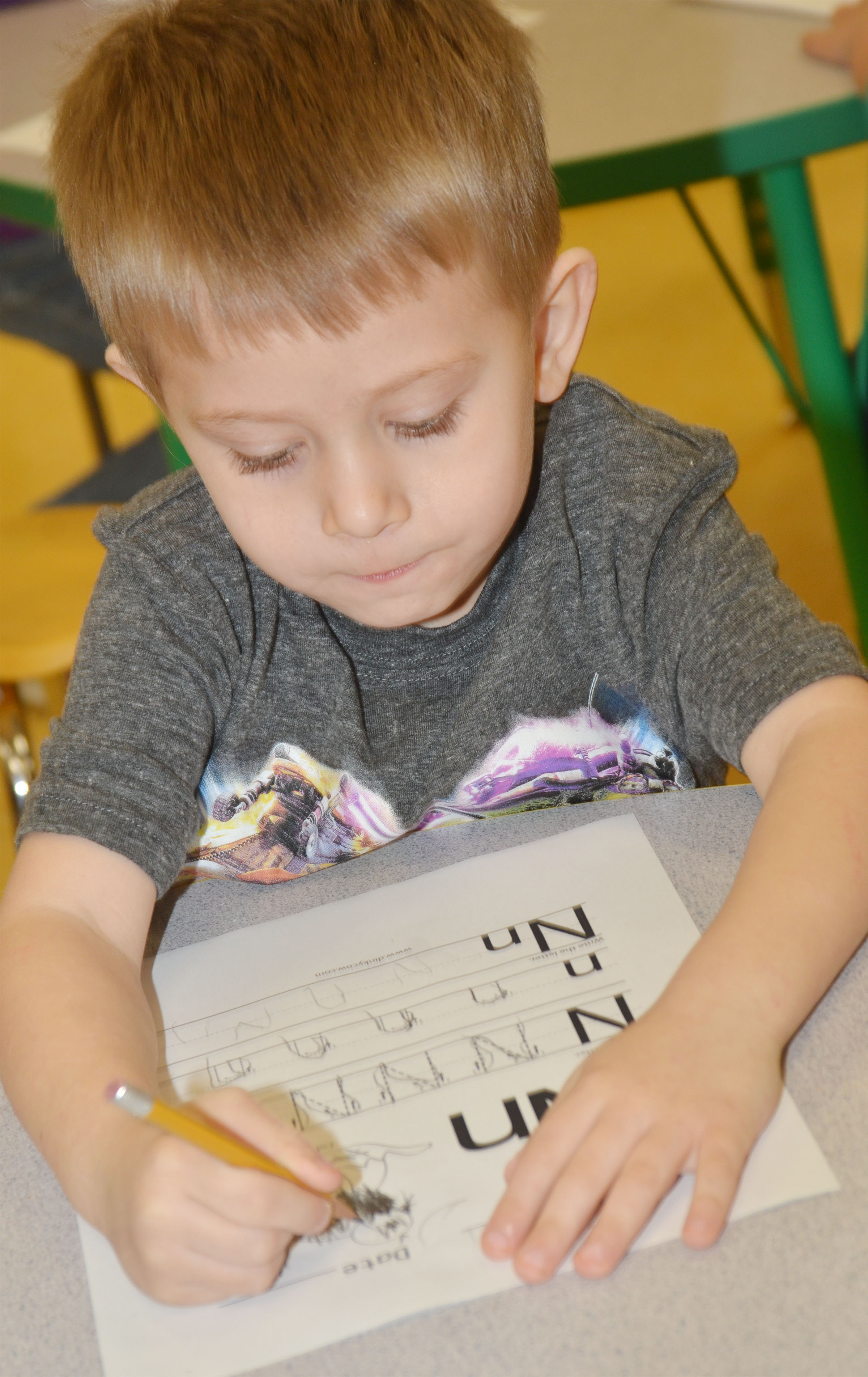 CES preschool student Elijah Russell writes the letter N.