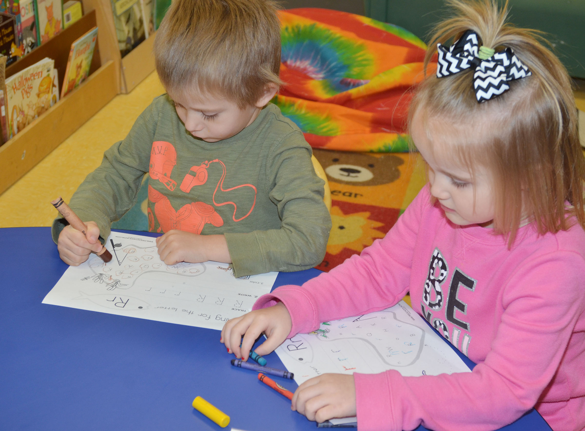 CES preschool students Elijah Russell, at left, and Trinity Dye practice writing the letter R.