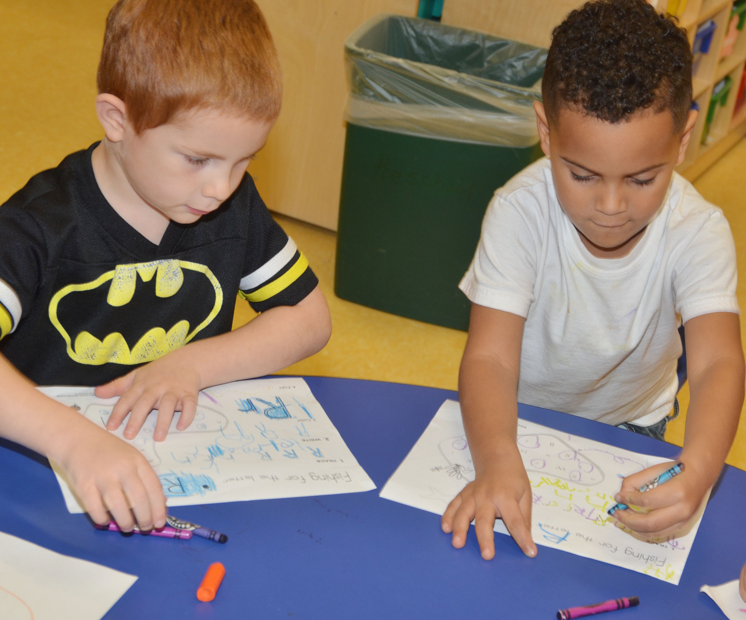 CES preschool students Kennon Dotson, at left, and Kingston Cowherd write the letter R.