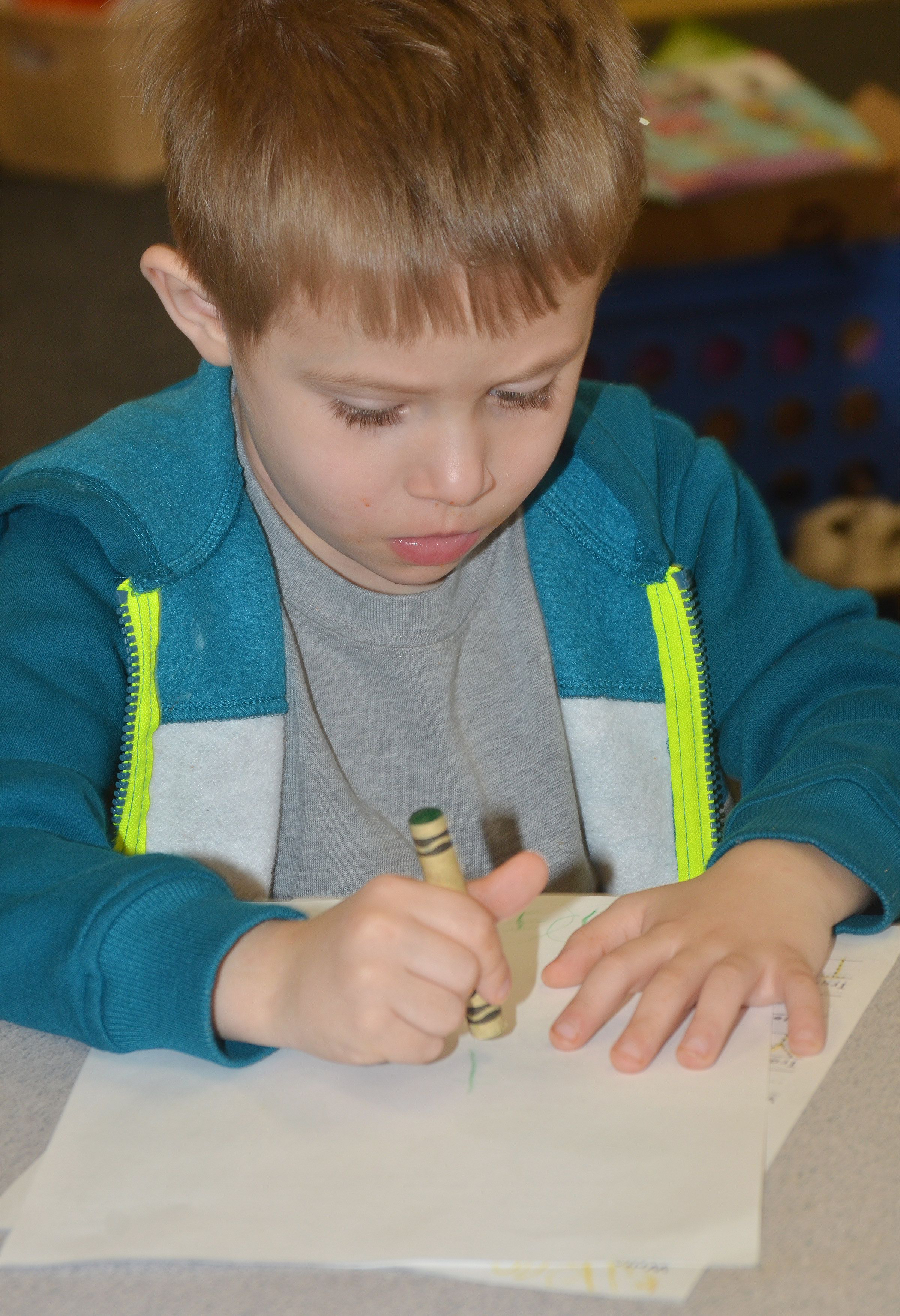 CES preschool student Elijah Russell writes the letter Y.