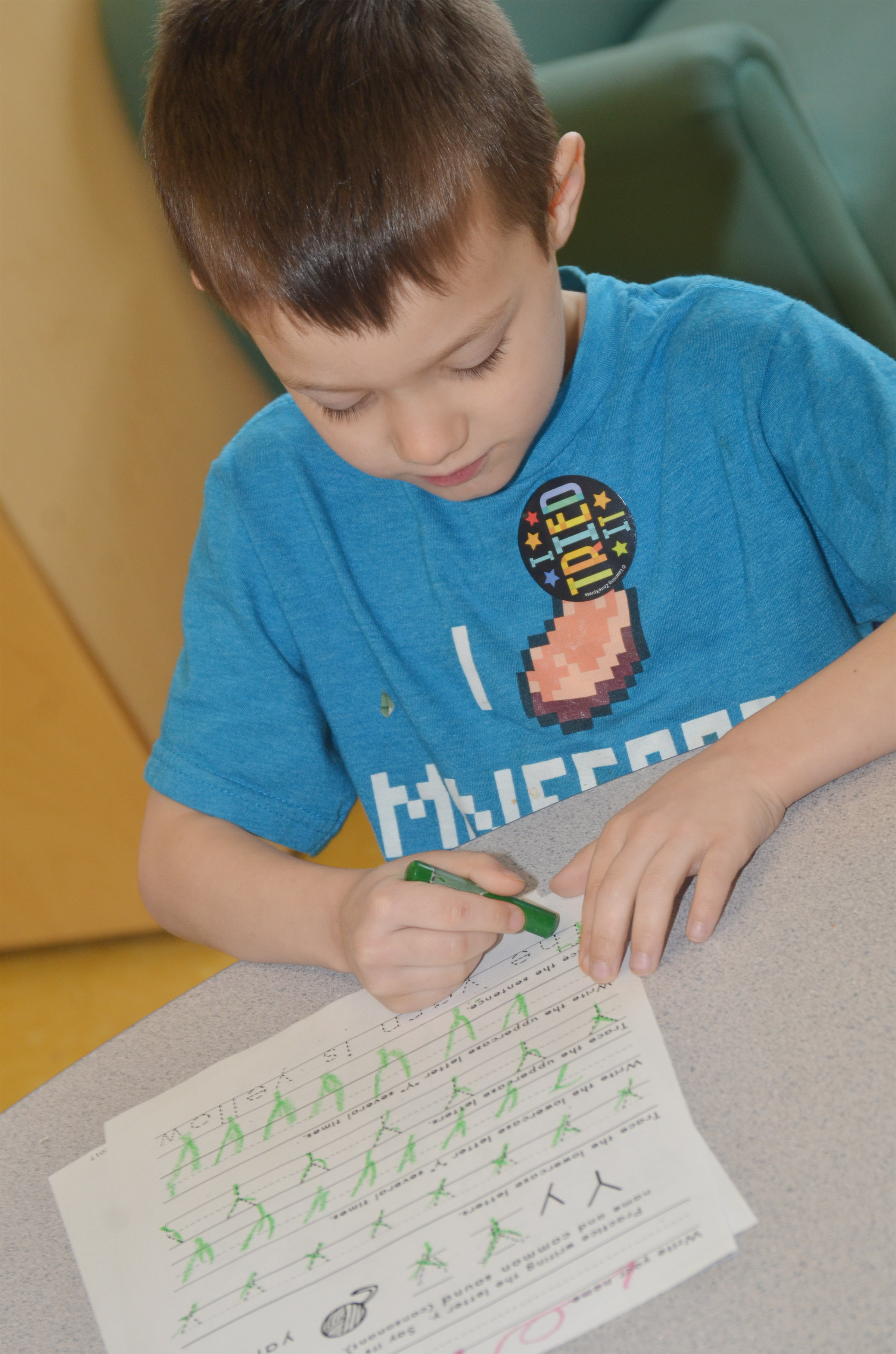CES preschool student Levi Ritchie practices writing the letter Y.
