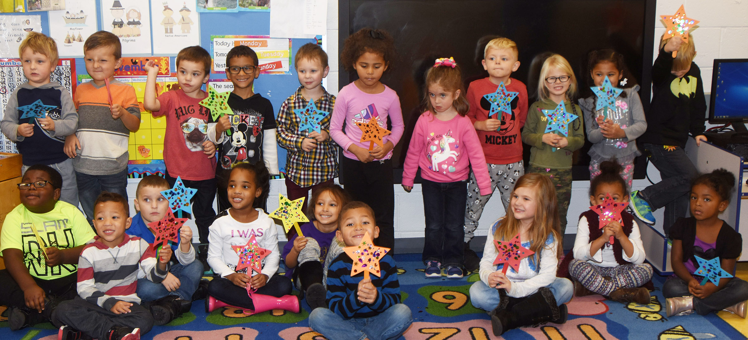 CES preschool students in Denise Spencer's class hold their magic wands.