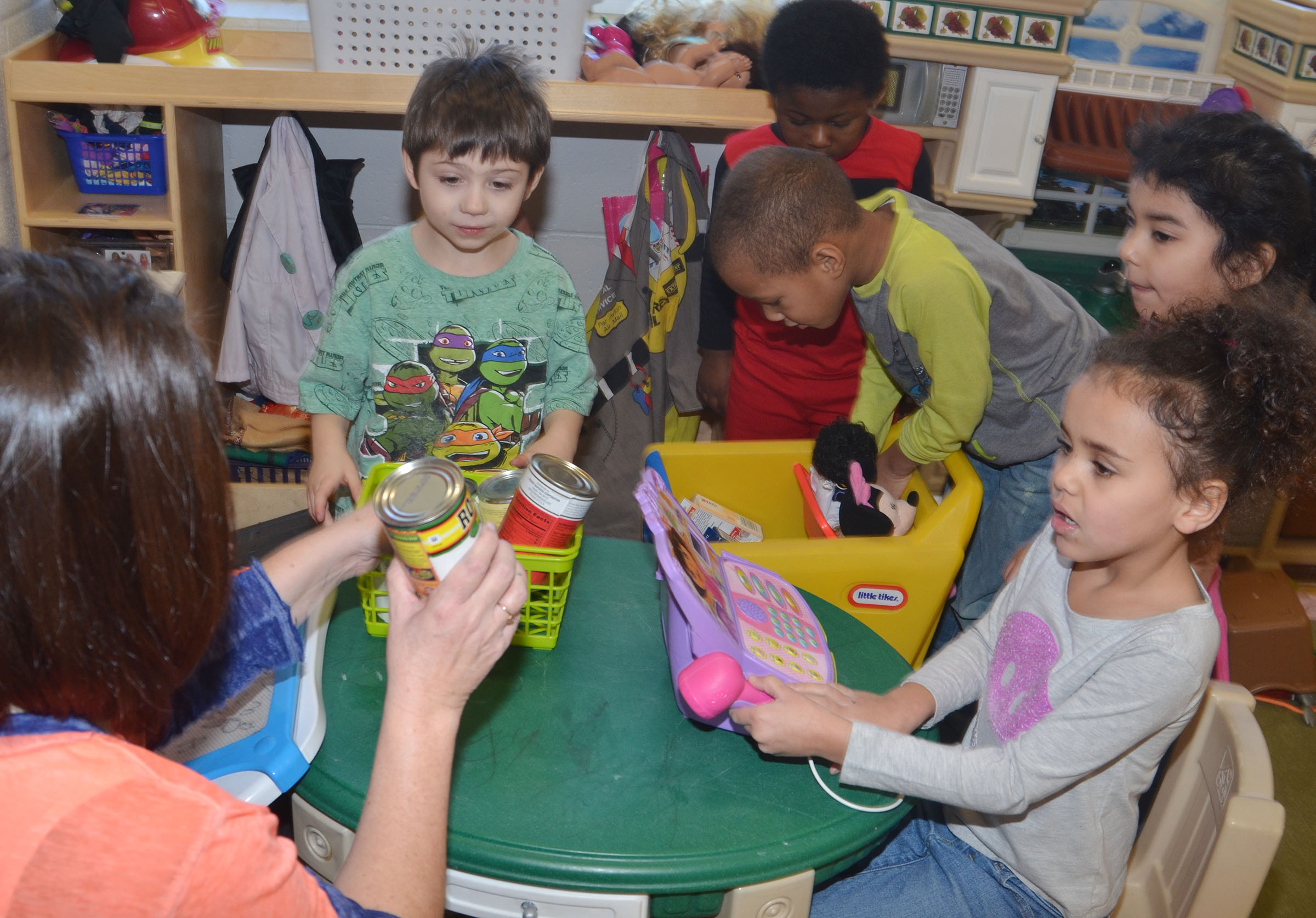 "CES preschool teacher Denise Spencer shops with her students, from left, Josiah Dean, LaTayvion Brown, Jamerius Miller and Aaliyah Moreno as Adelyn Litsey waits to take their ""money."""