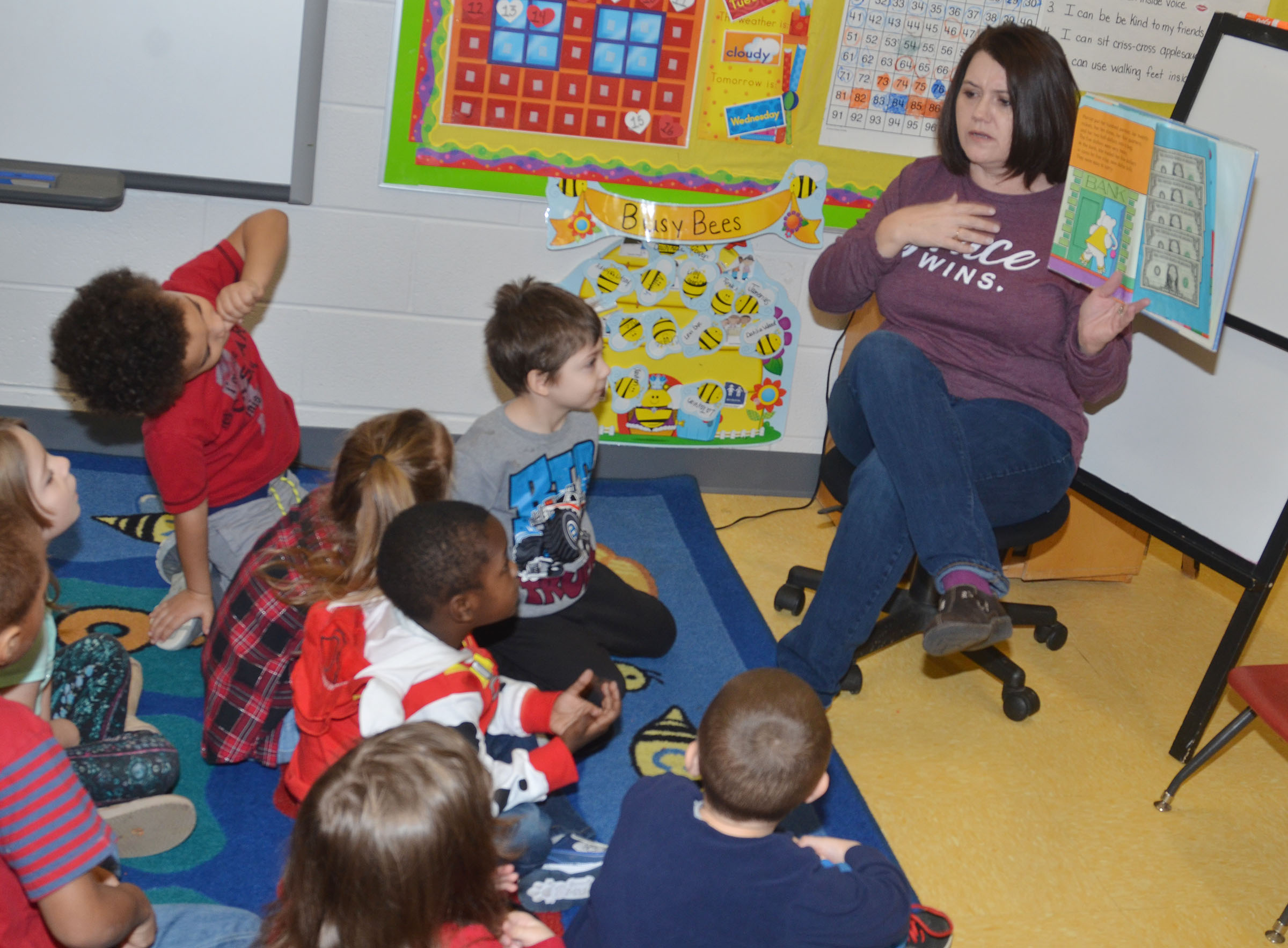 CES preschool teacher Denise Spencer talks to her students about money.