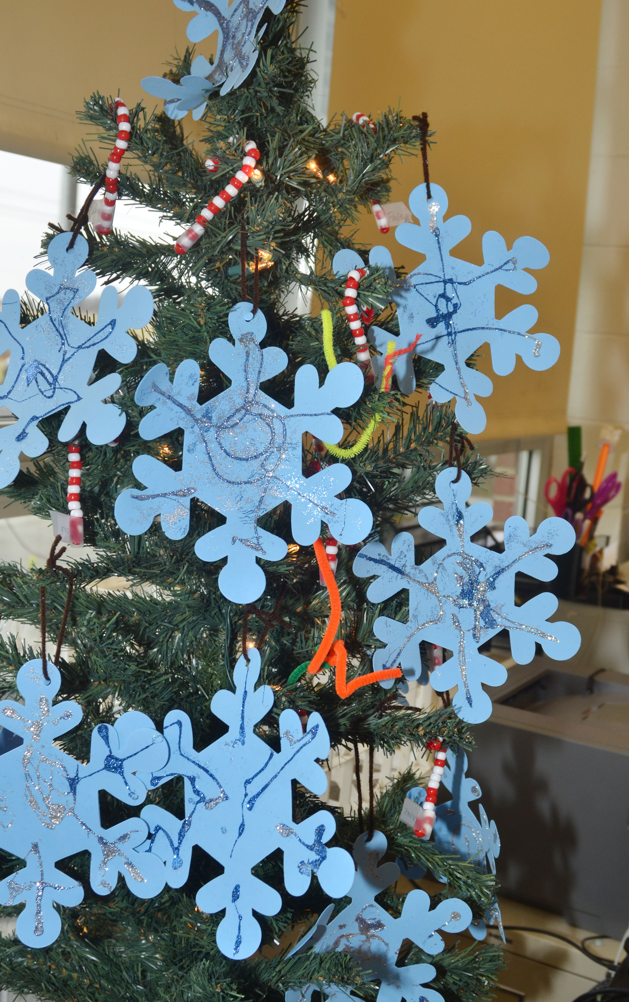 CES preschool students made snowflake, candy cane and other ornaments for their Christmas tree.