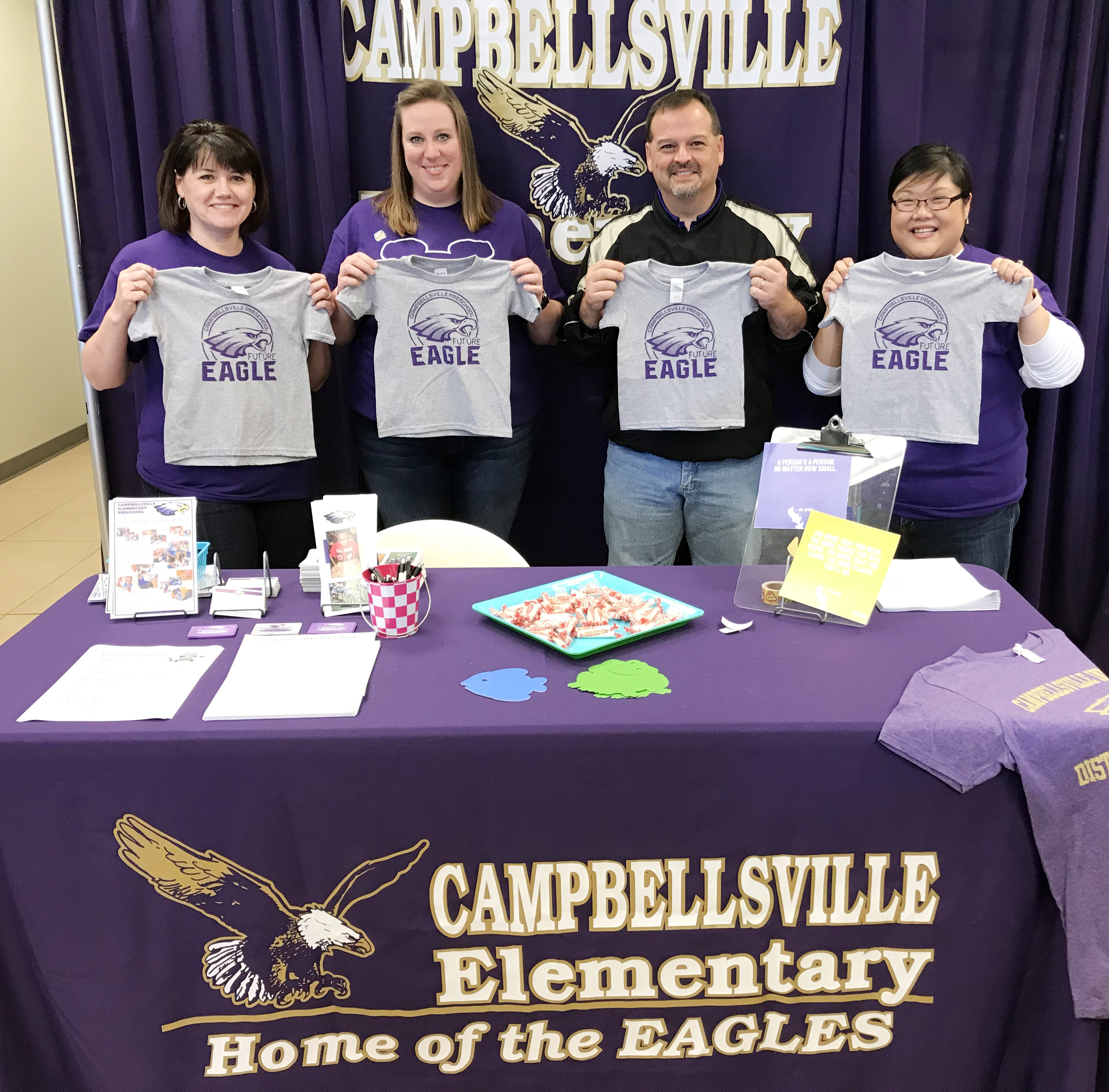 "From left, CES preschool teachers Denise Spencer and Julie Shelton, Director Ricky Hunt and assistant Brittany Johnson hold ""Future Eagle"" t-shirts that were given to students attending Preschool Palooza."