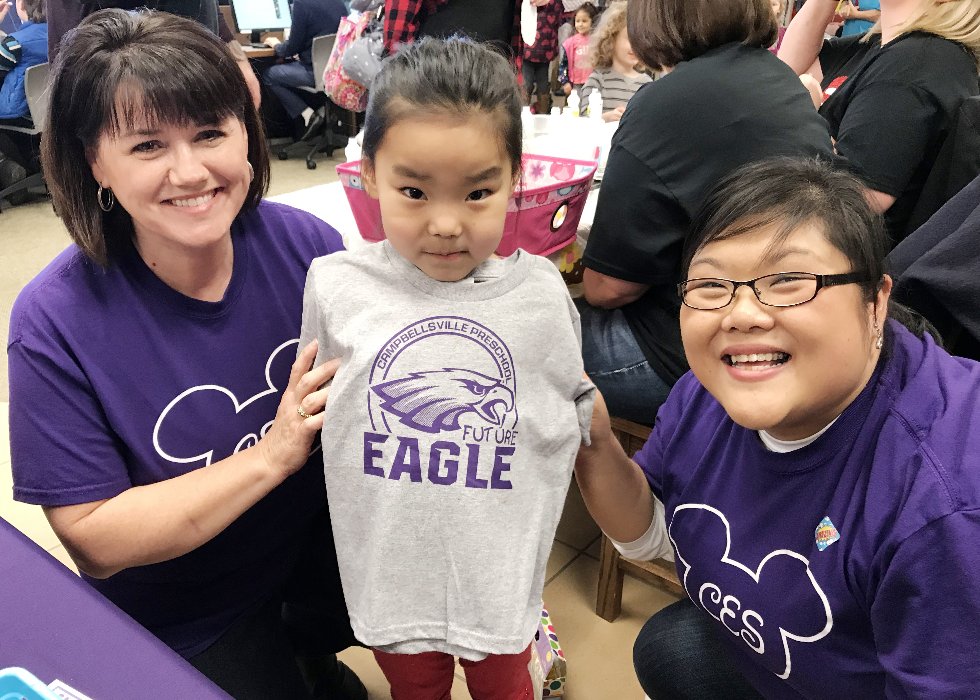 "CES preschool teacher Denise Spencer, at left, and assistant Brittany Johnson pose for a photo with their student Marla Bat, holding her ""Future Eagle"" t-shirt."
