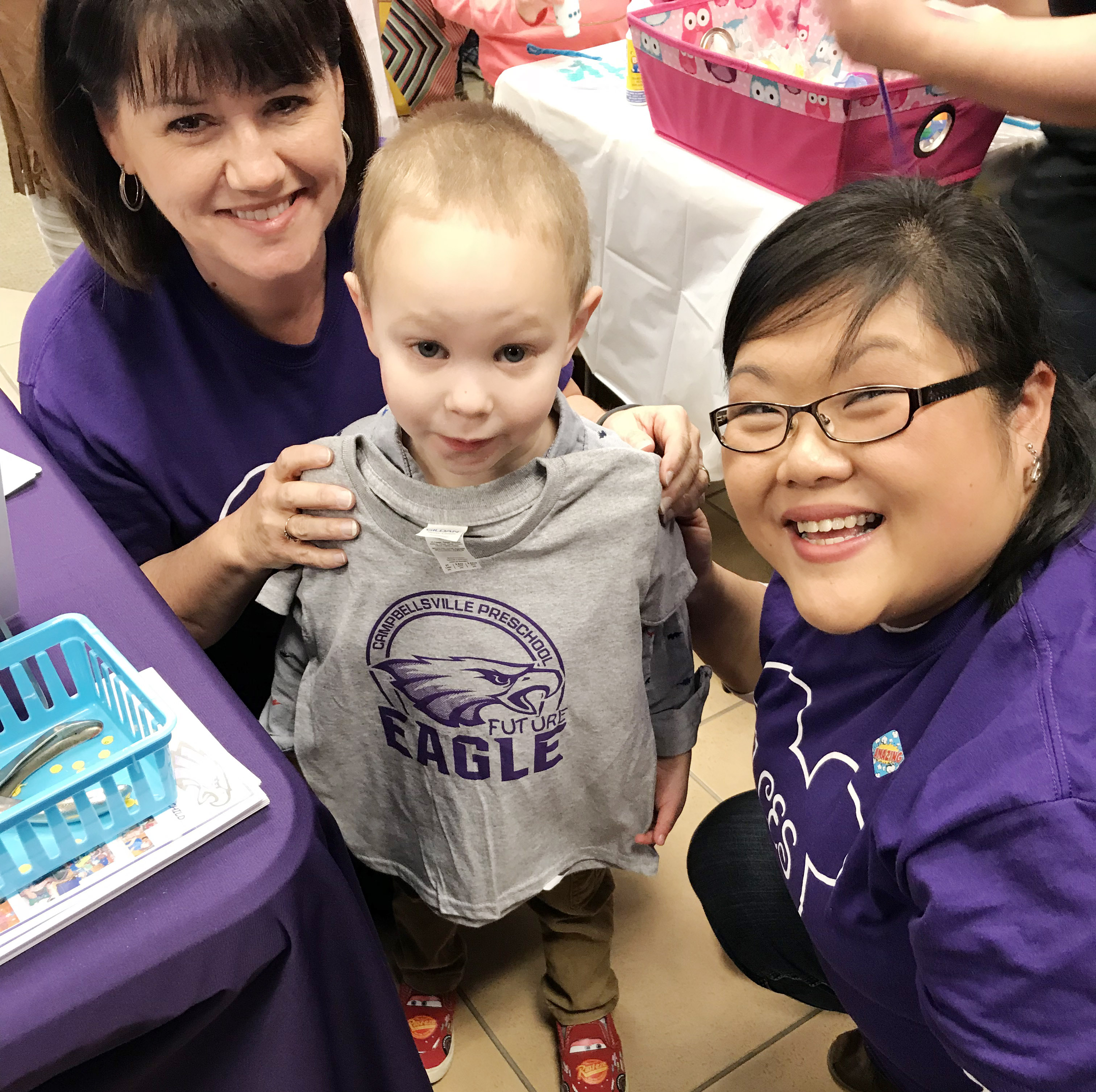 "CES preschool teacher Denise Spencer, at left, and assistant Brittany Johnson pose for a photo with their student Cole Britton, holding his ""Future Eagle"" t-shirt."