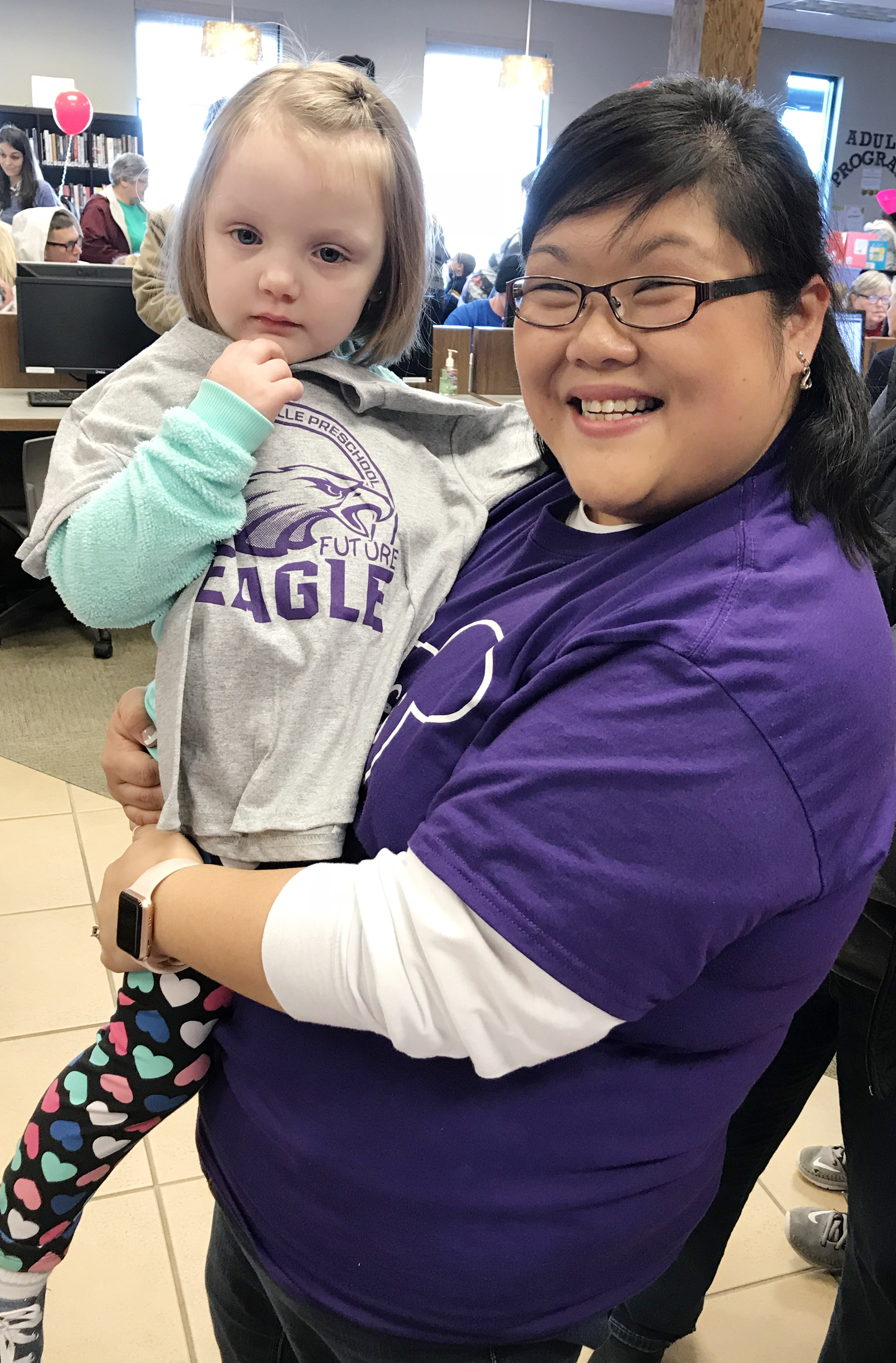CES preschool assistant Brittany Johnson poses for a photo with Karlie Peppers, who is a future Eagle student.