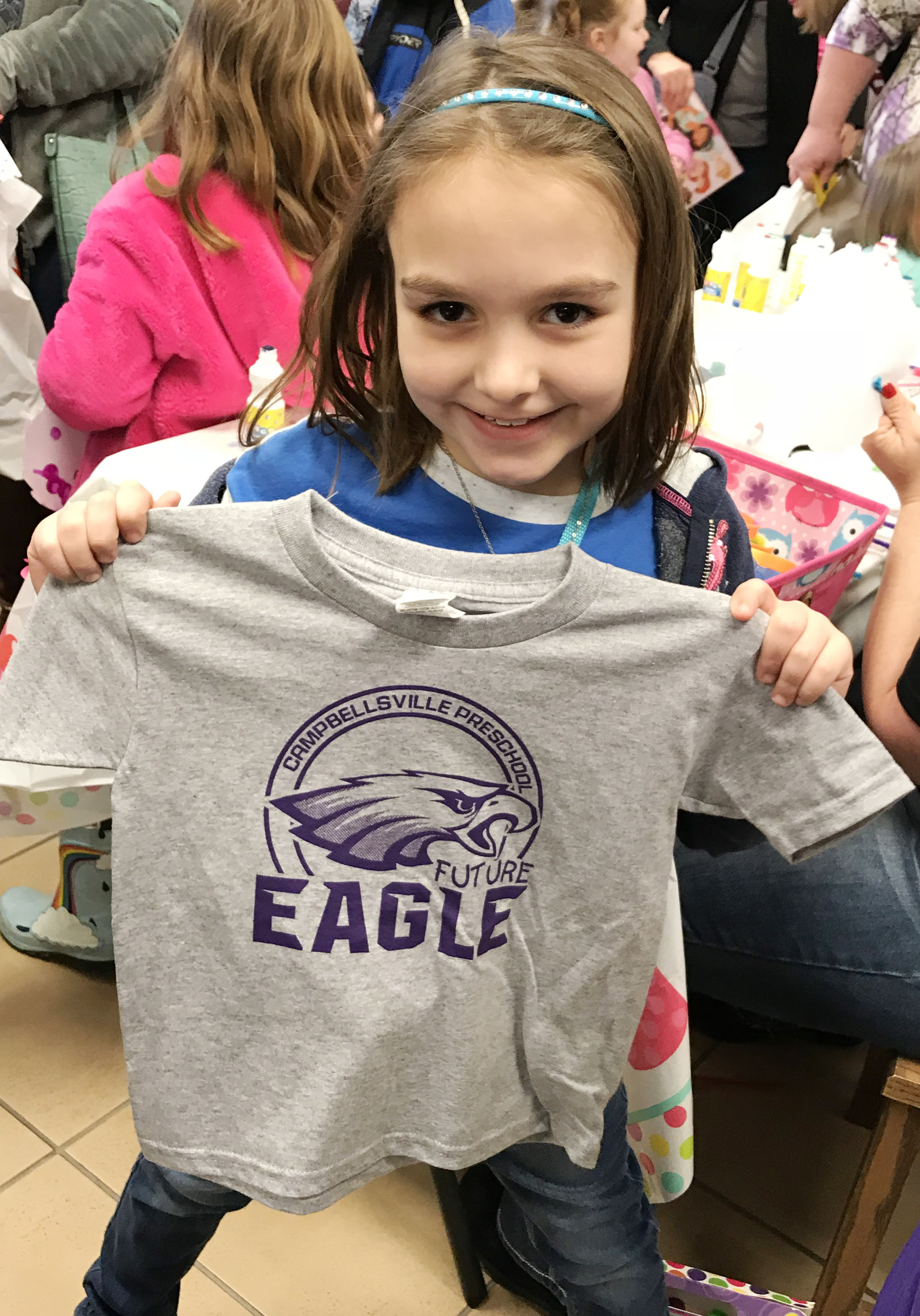 "CES first-grader Aubrey Allen holds her ""Future Eagle"" t-shirt."