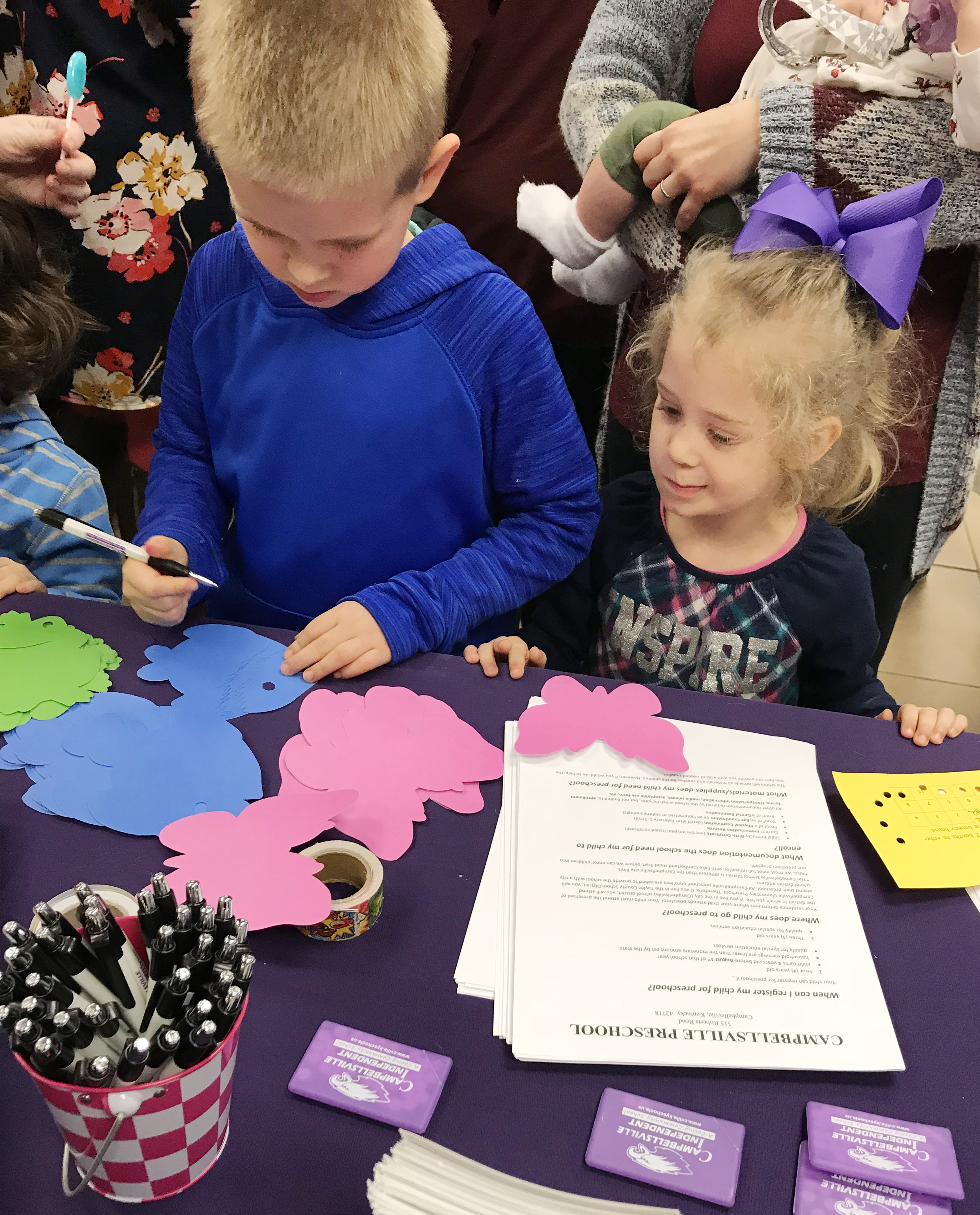 CES kindergartener Jacob Parris decorates a fish with his sister, who is a future Eagle.
