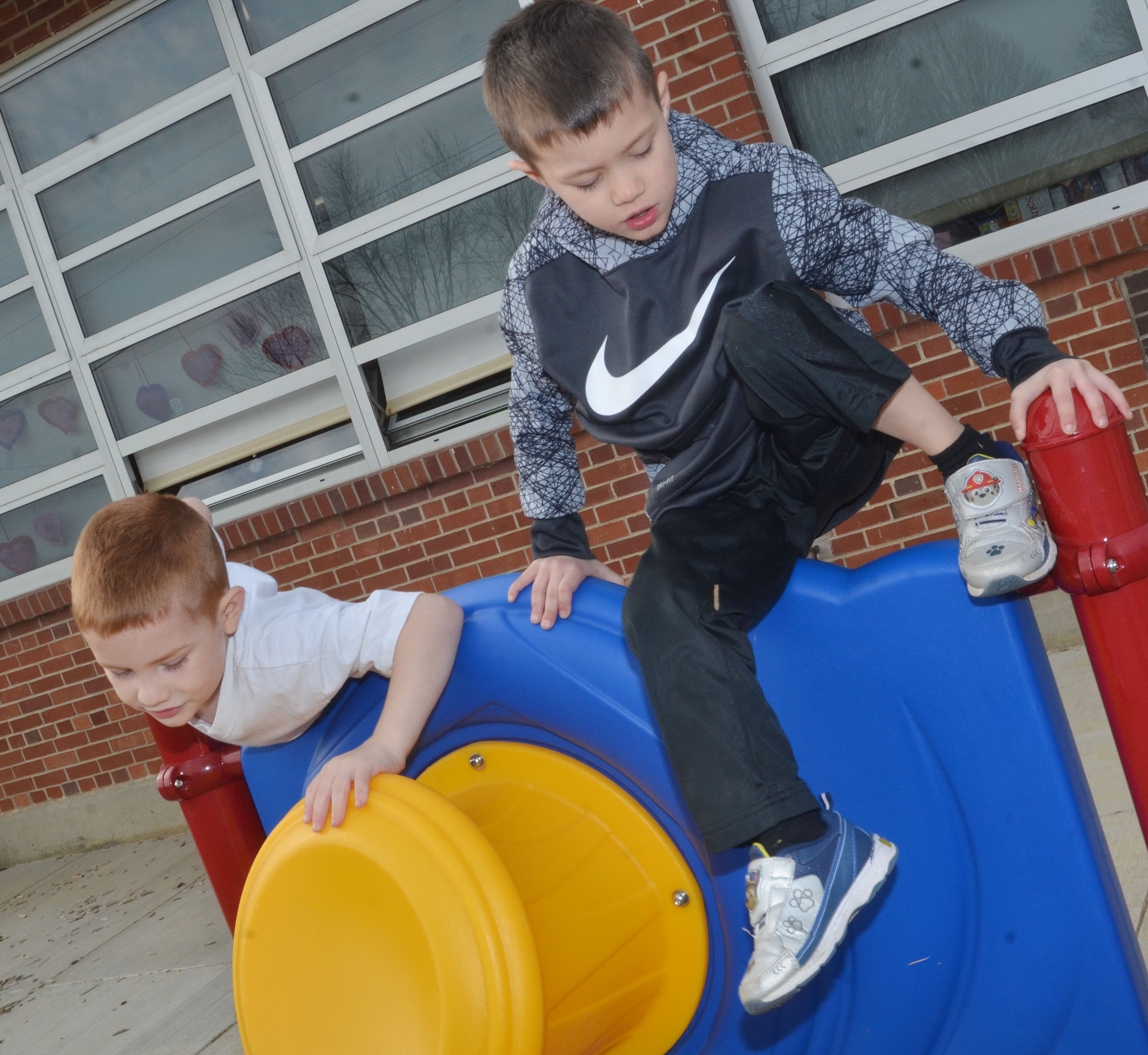 CES preschool students Kennon Dotson, at left, and Levi Ritchie climb high.