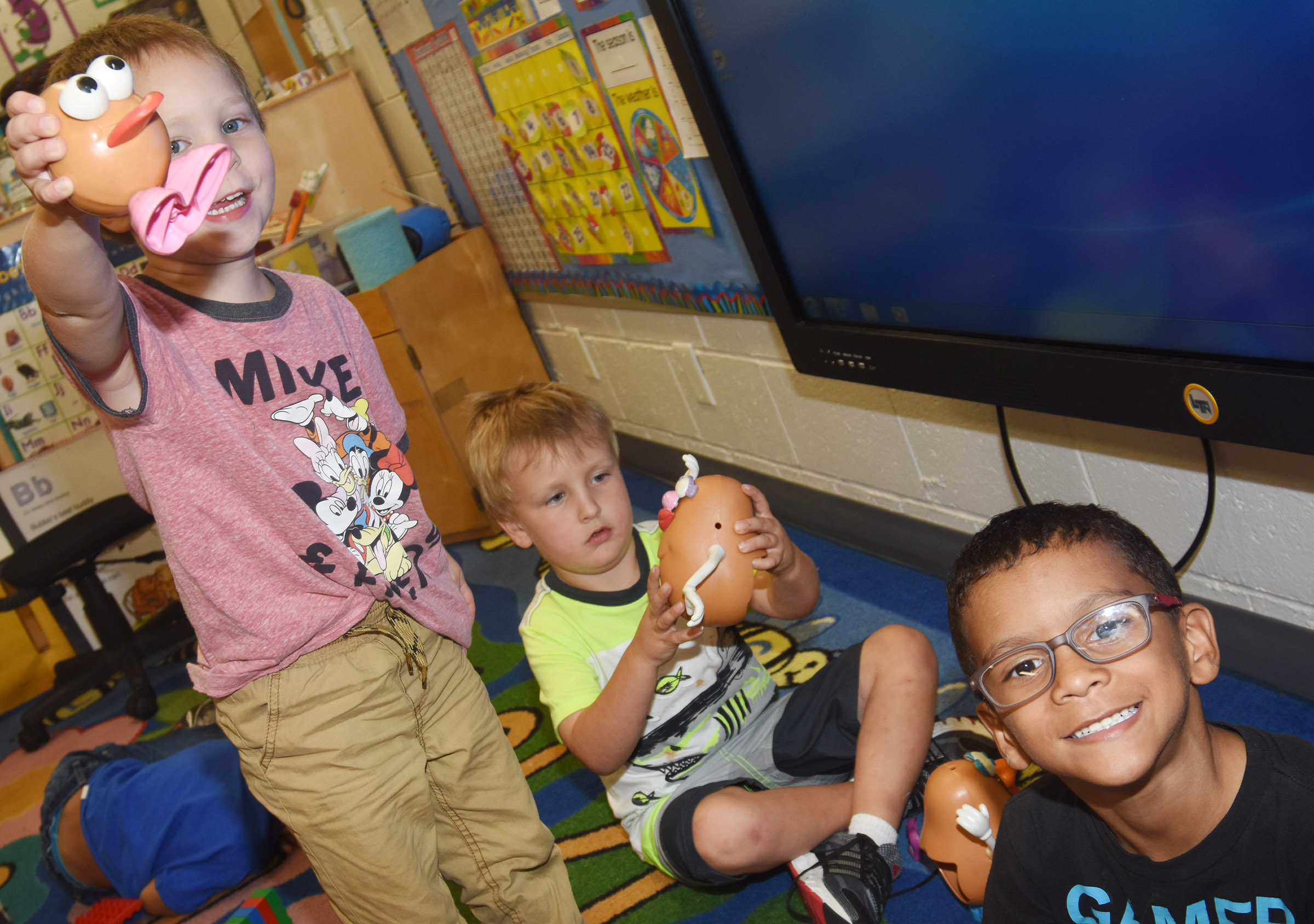 From left, CES preschool students Cole Britton, Gannon Scott and Eli Howard hold their Mr. Potato Head toys.