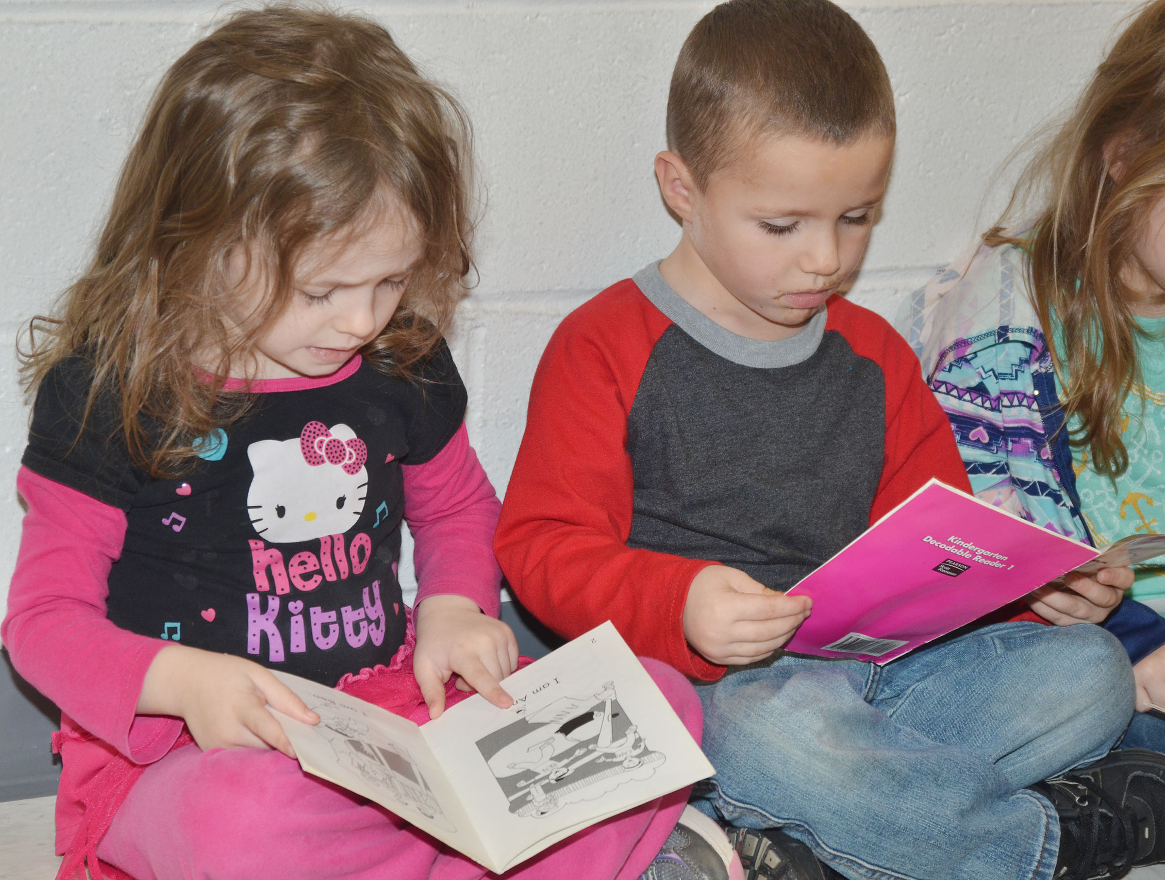 CES preschool students Dahlia Ward, at left, and Triton Bradshaw read together.