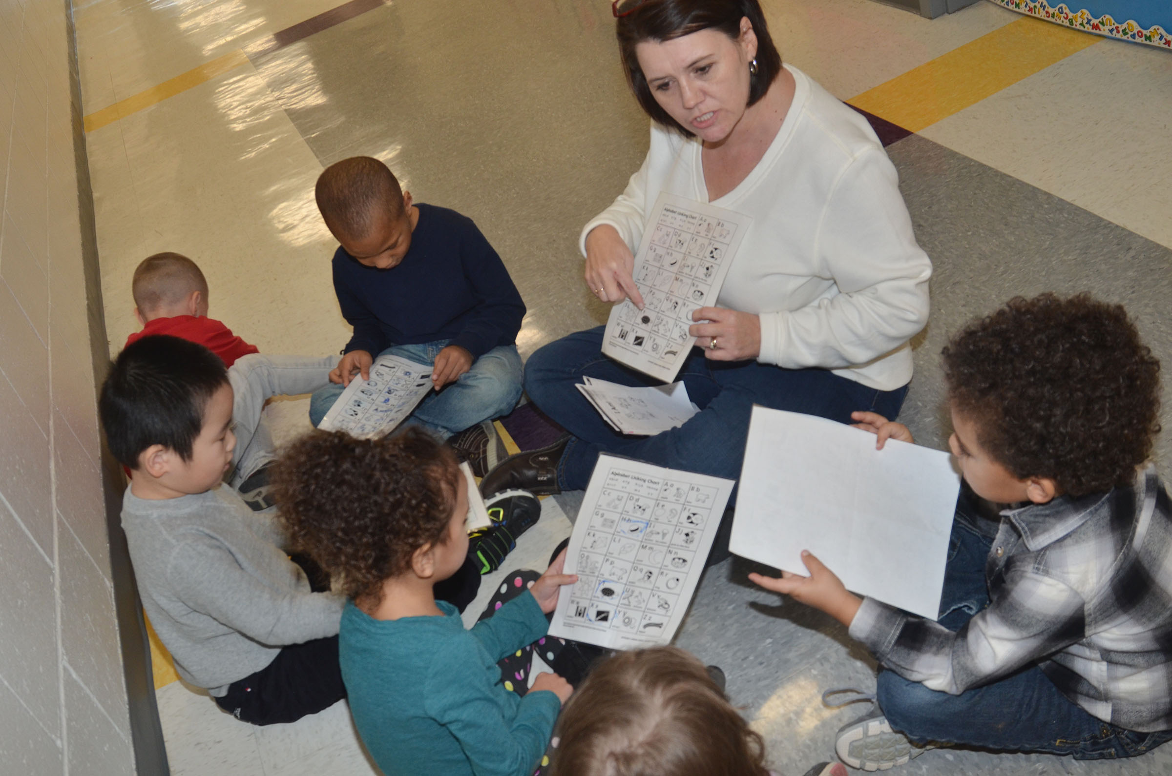 CES preschool teacher Denise Spencer helps her students learn the alphabet.