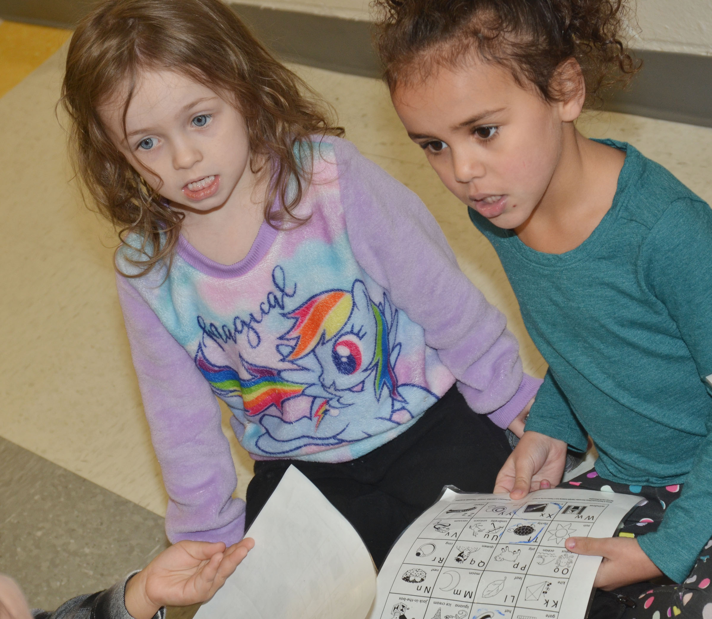 CES preschool students Dahlia Ward, at left, and Adelyn Litsey recite the alphabet.