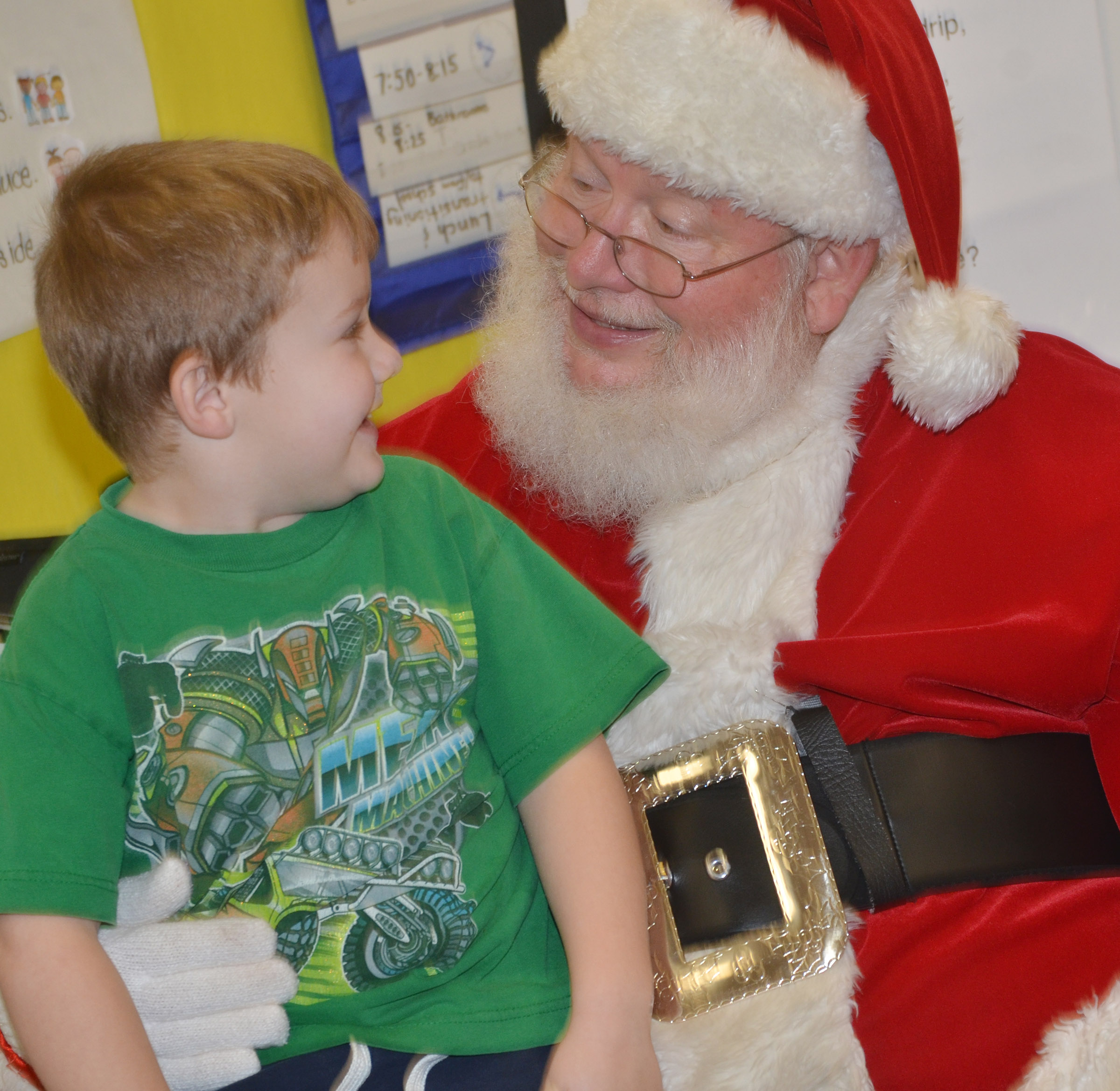 CES preschool student Levi Dye smiles as he talks to Santa.