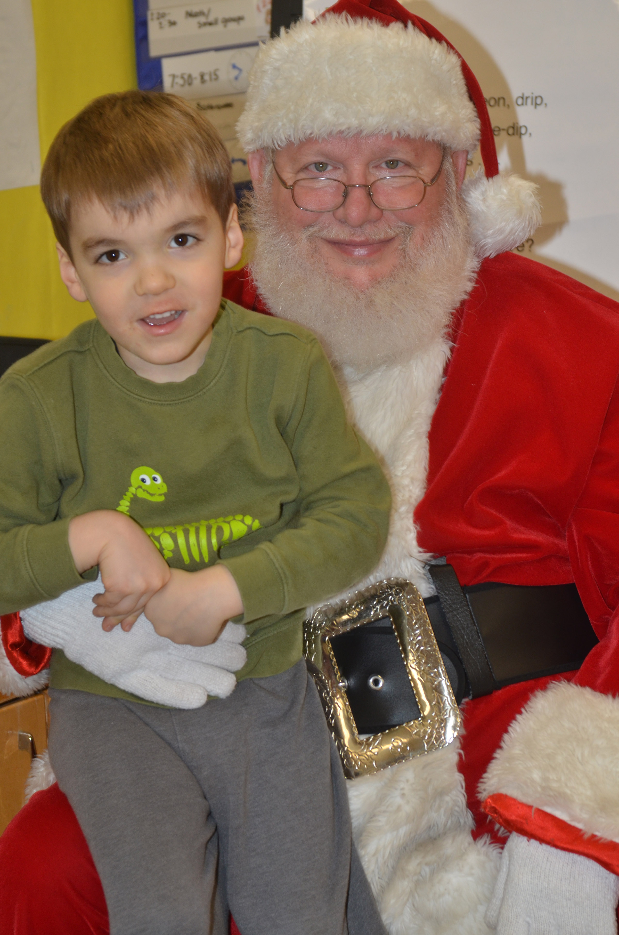 CES preschool student Finley Williams smiles for a photo with Santa.