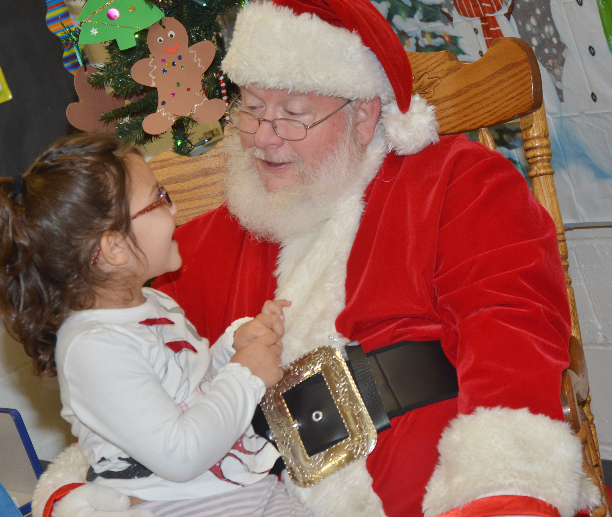 CES preschool student Rylee Karr tells Santa what she wants for Christmas.