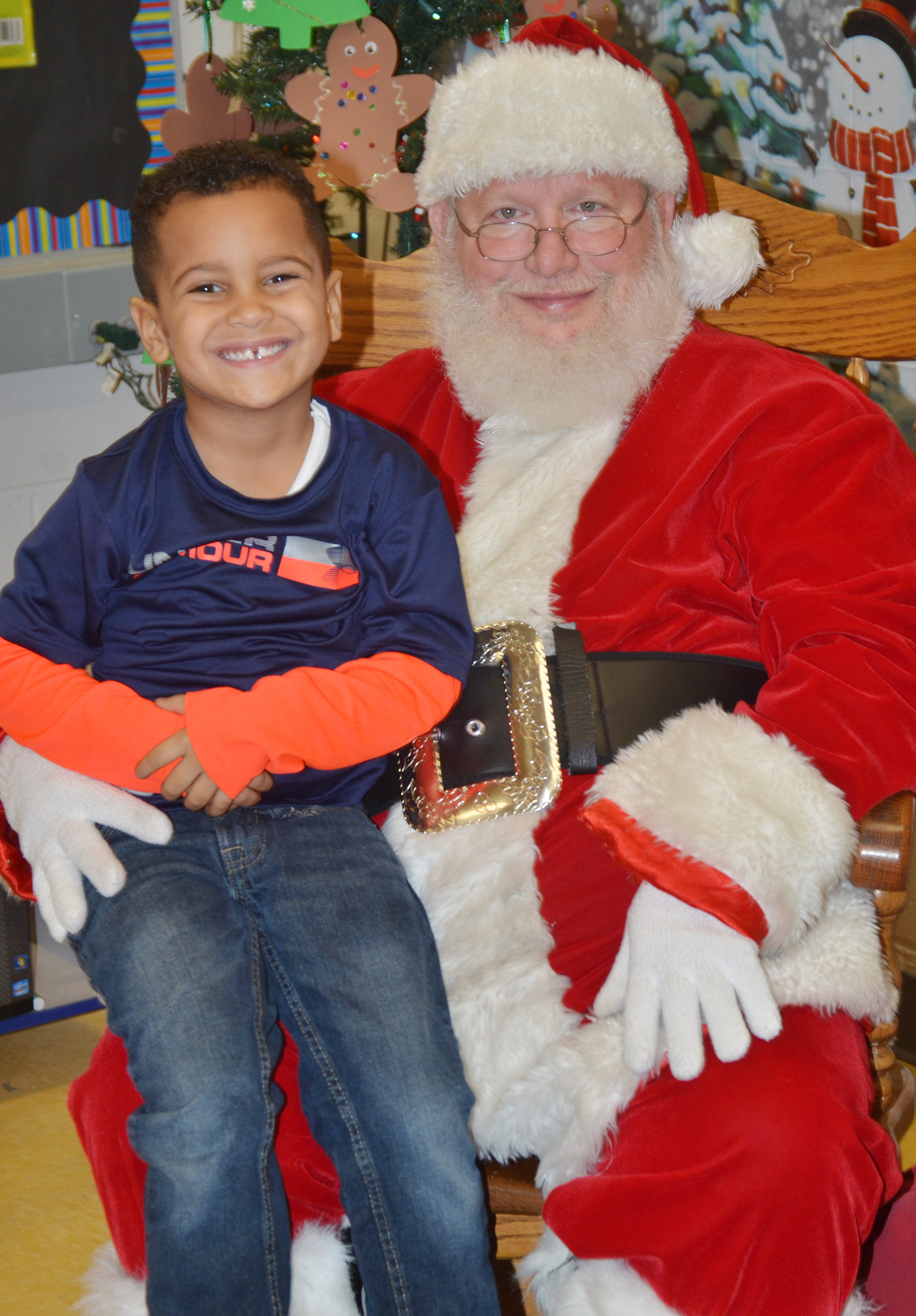 CES preschool student Kingston Cowherd smiles for a photo with Santa.