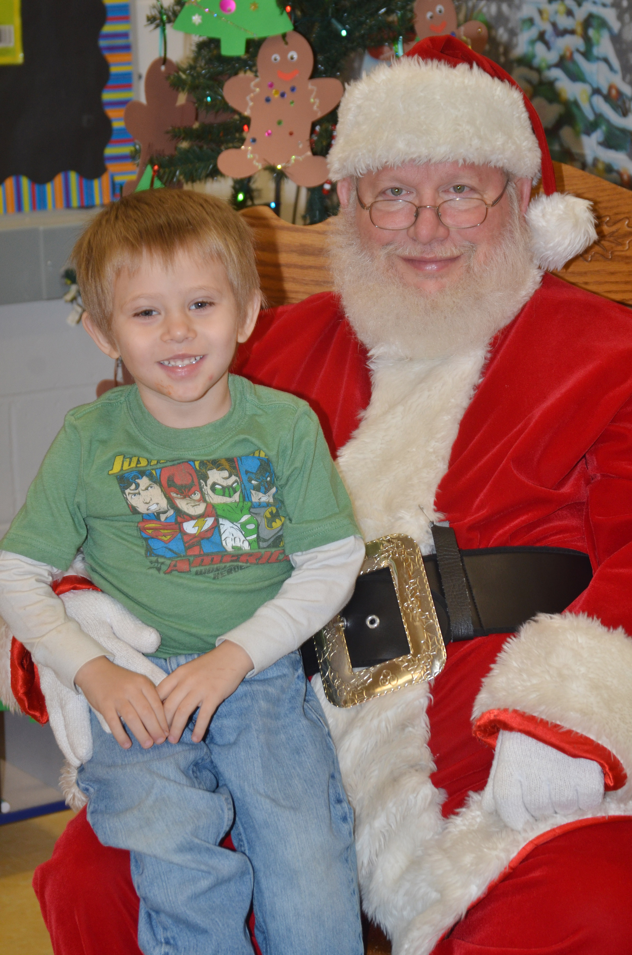 CES preschool student Elijah Russell smiles for a photo with Santa.