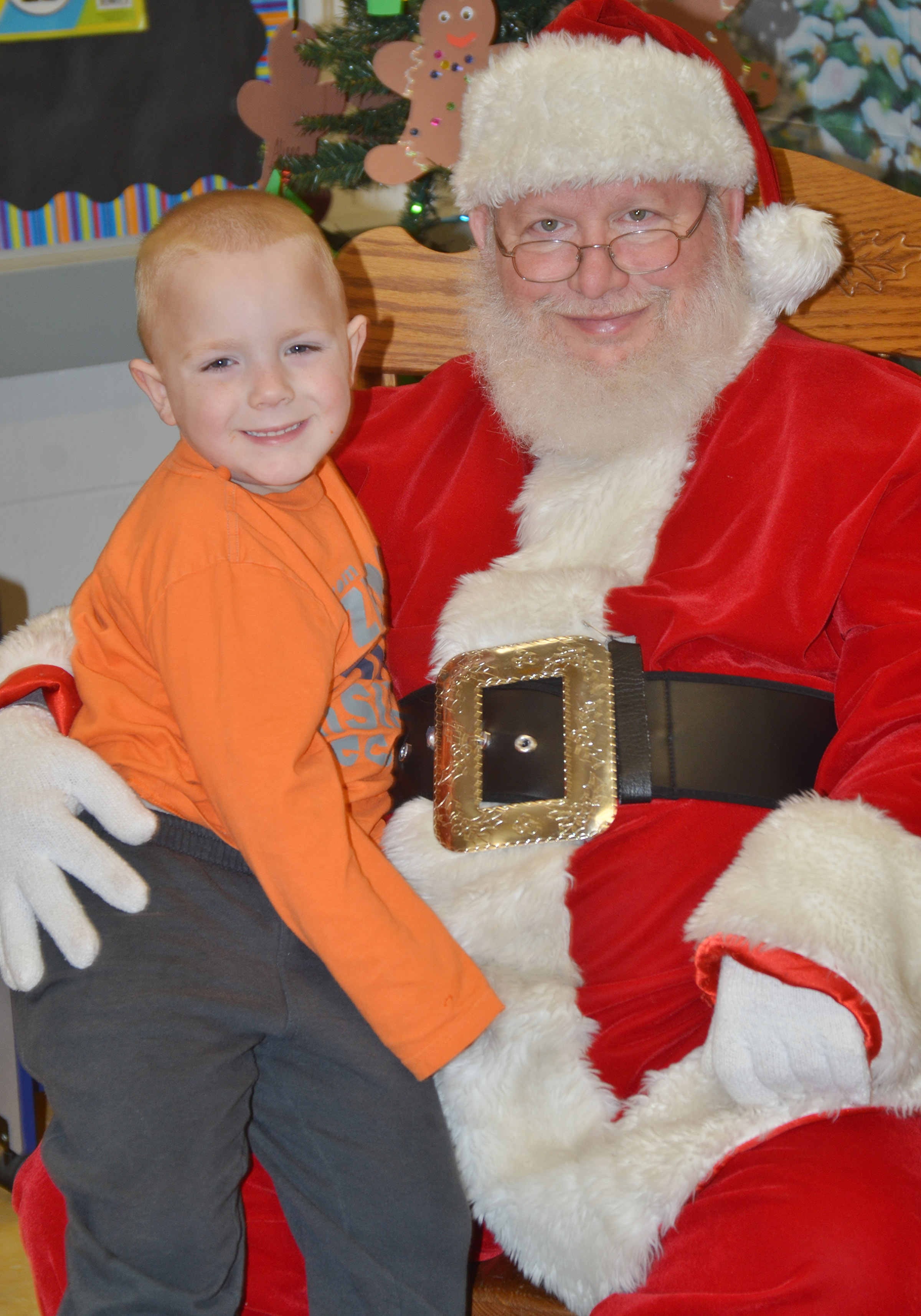 CES preschool student Anthony McClure smiles for a photo with Santa.