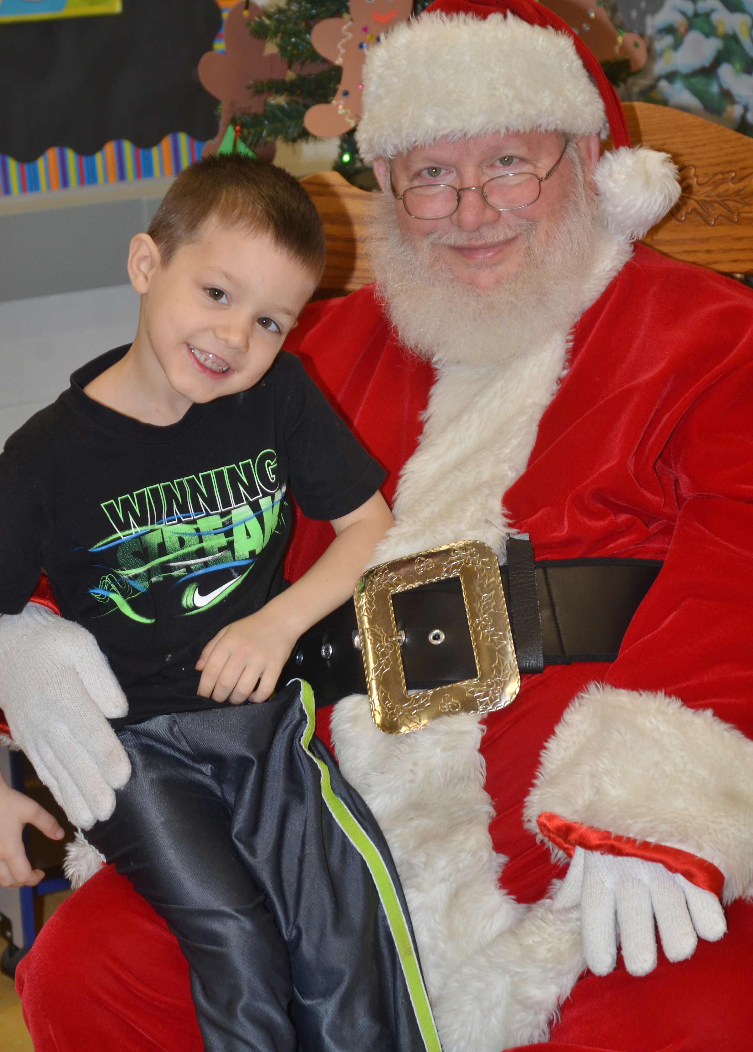 CES preschool student Levi Ritchie smiles for a photo with Santa.