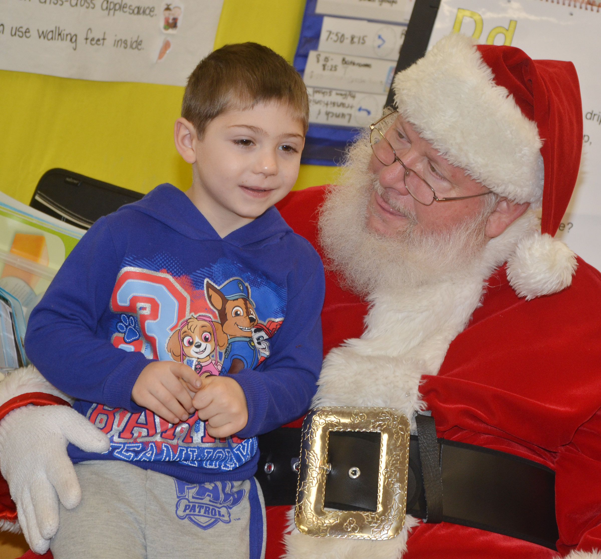 CES preschool student Josiah Dean talks to Santa.