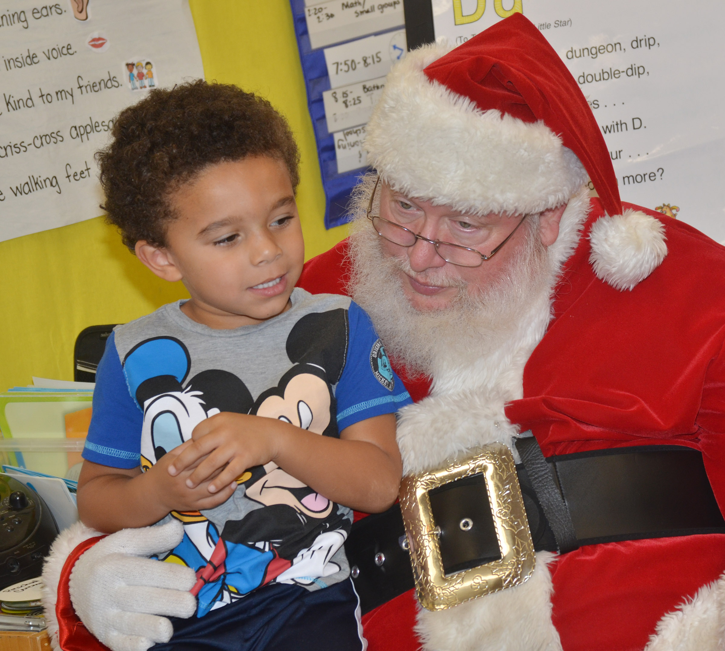 CES preschool student Tyrek Moore talks to Santa.