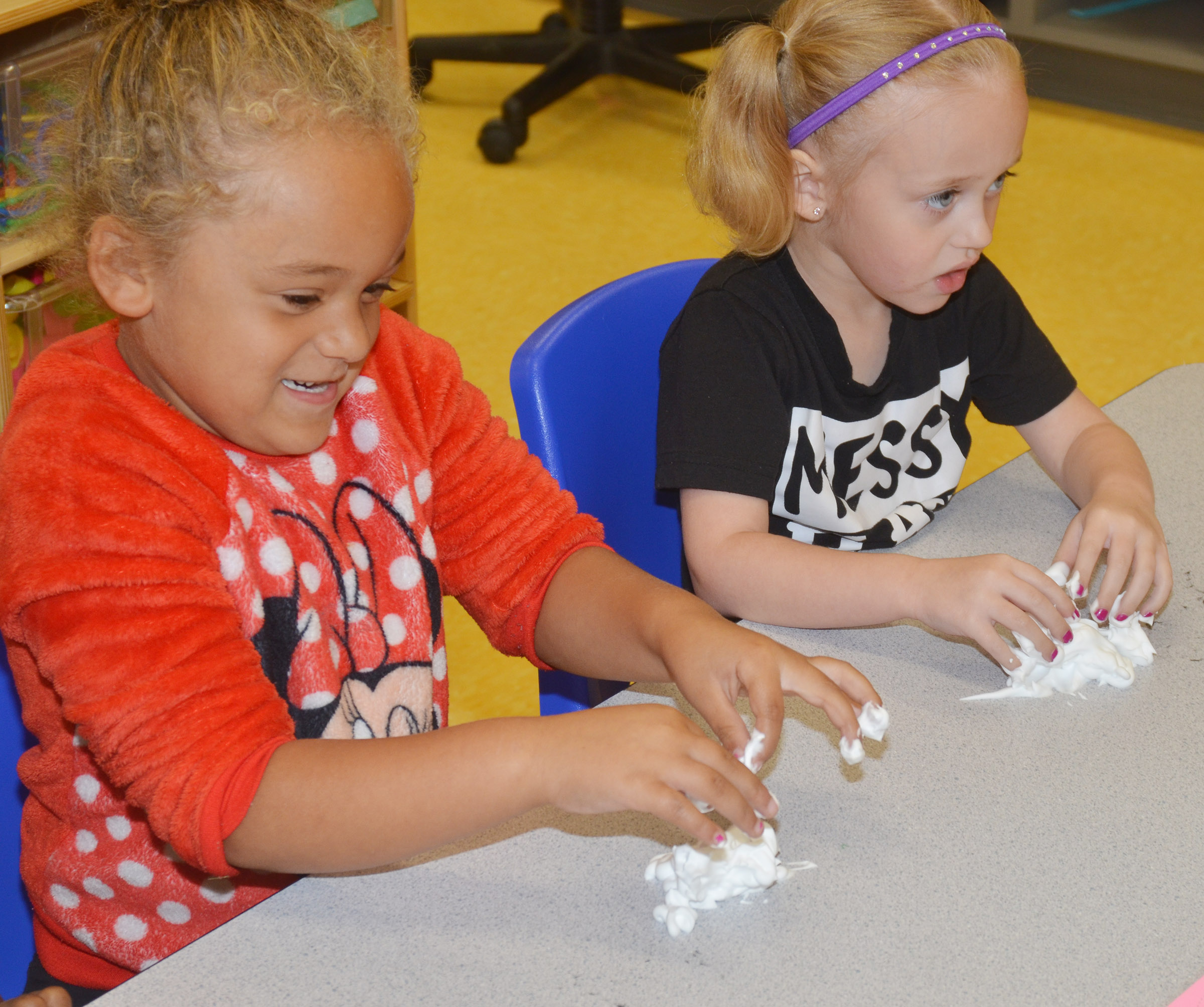 CES preschool students Layla Barbee, at left, and Kylie Thompson touch their shaving cream.