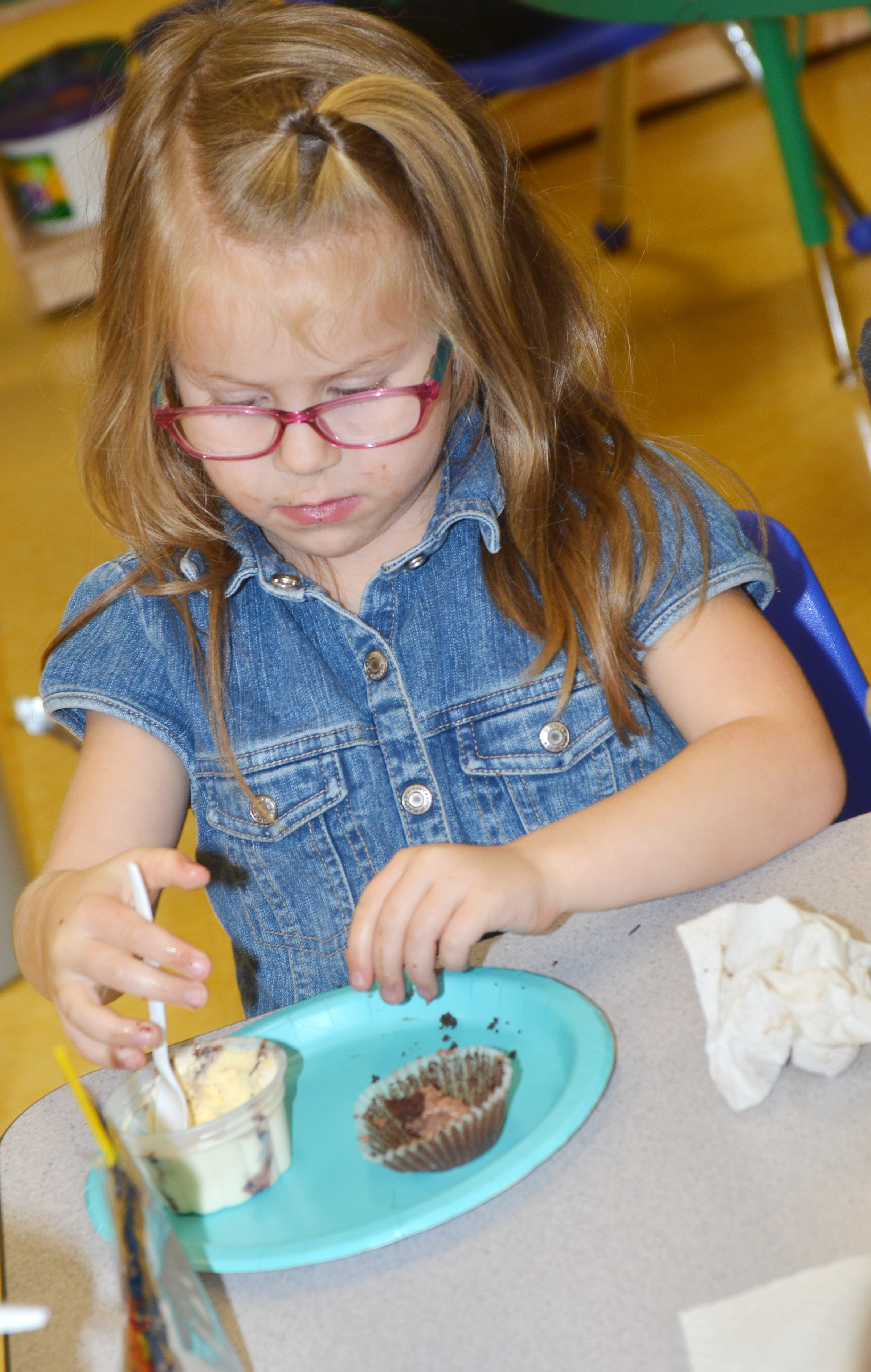 CES preschool student Charlotte Coots enjoys her ice cream.