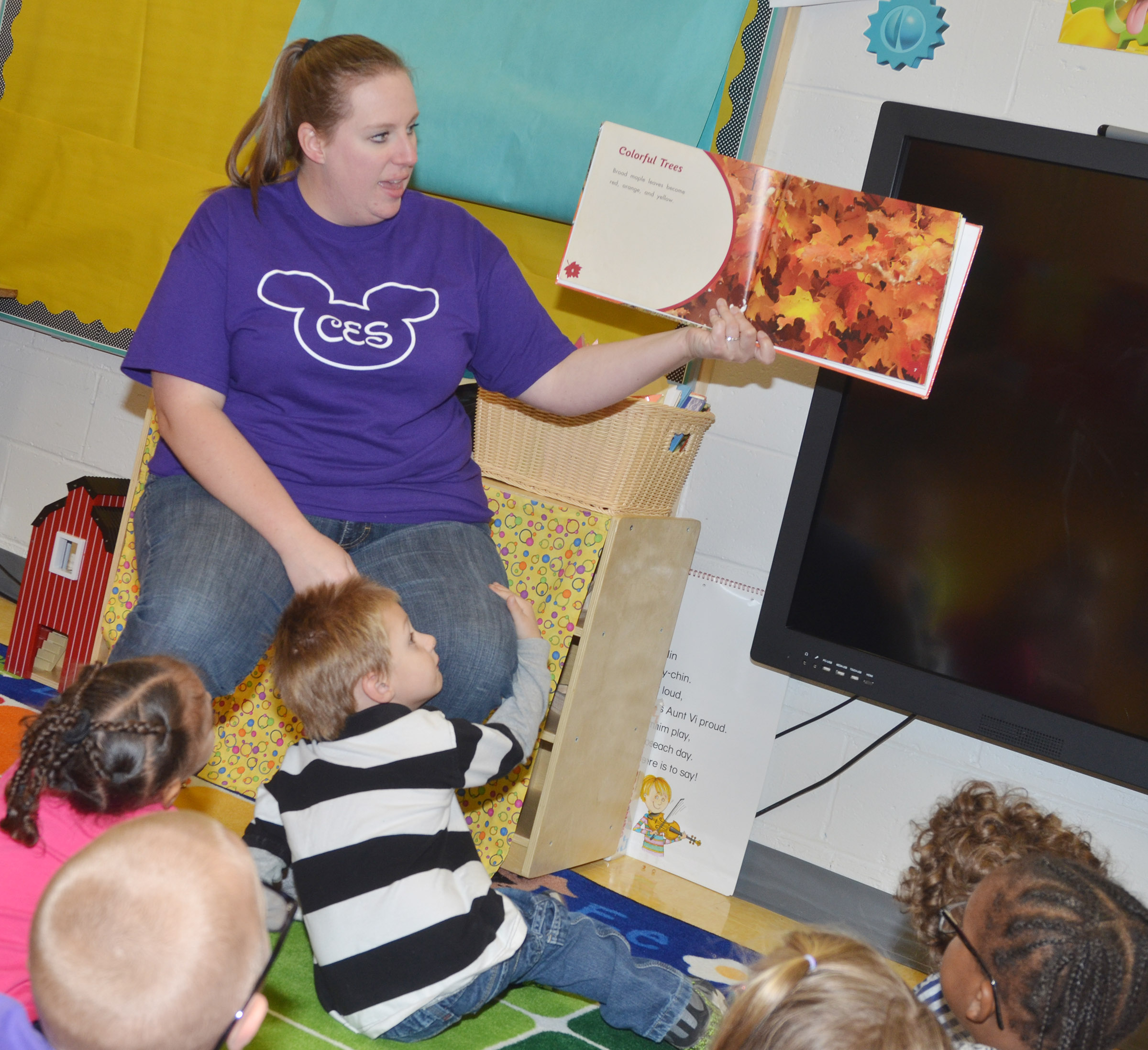 CES preschool teacher Julie Shelton reads a book about fall to her students.