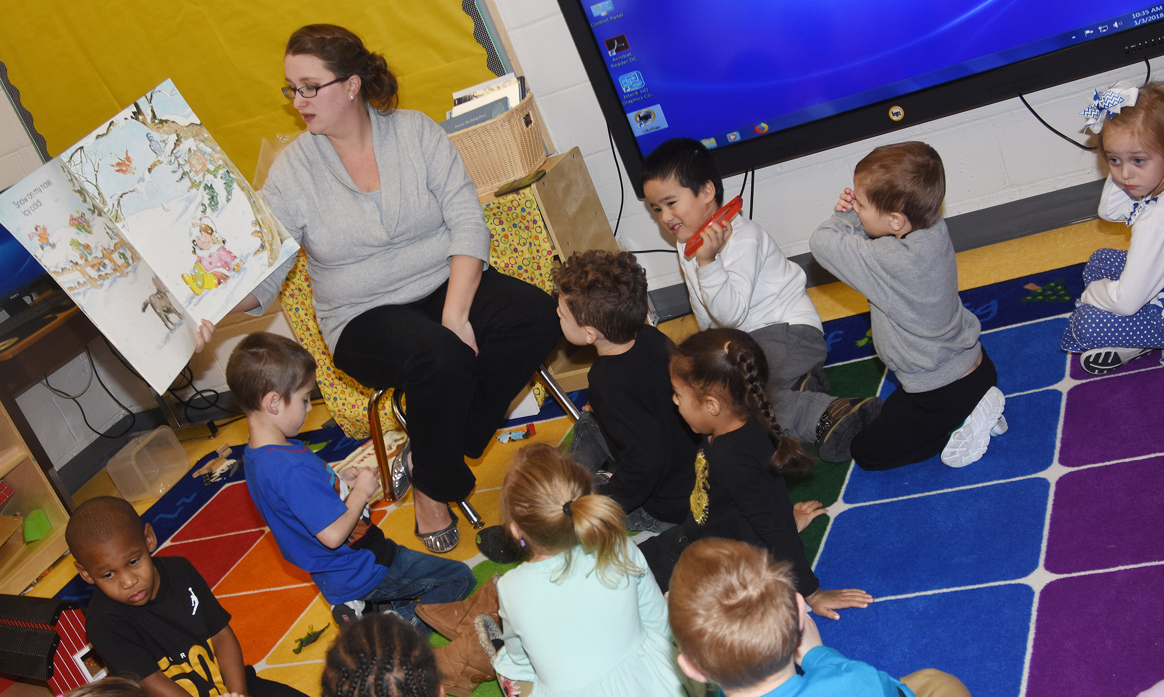 CES preschool assistant Jessica Williams talks to students about snow and how much fun they have playing in it.