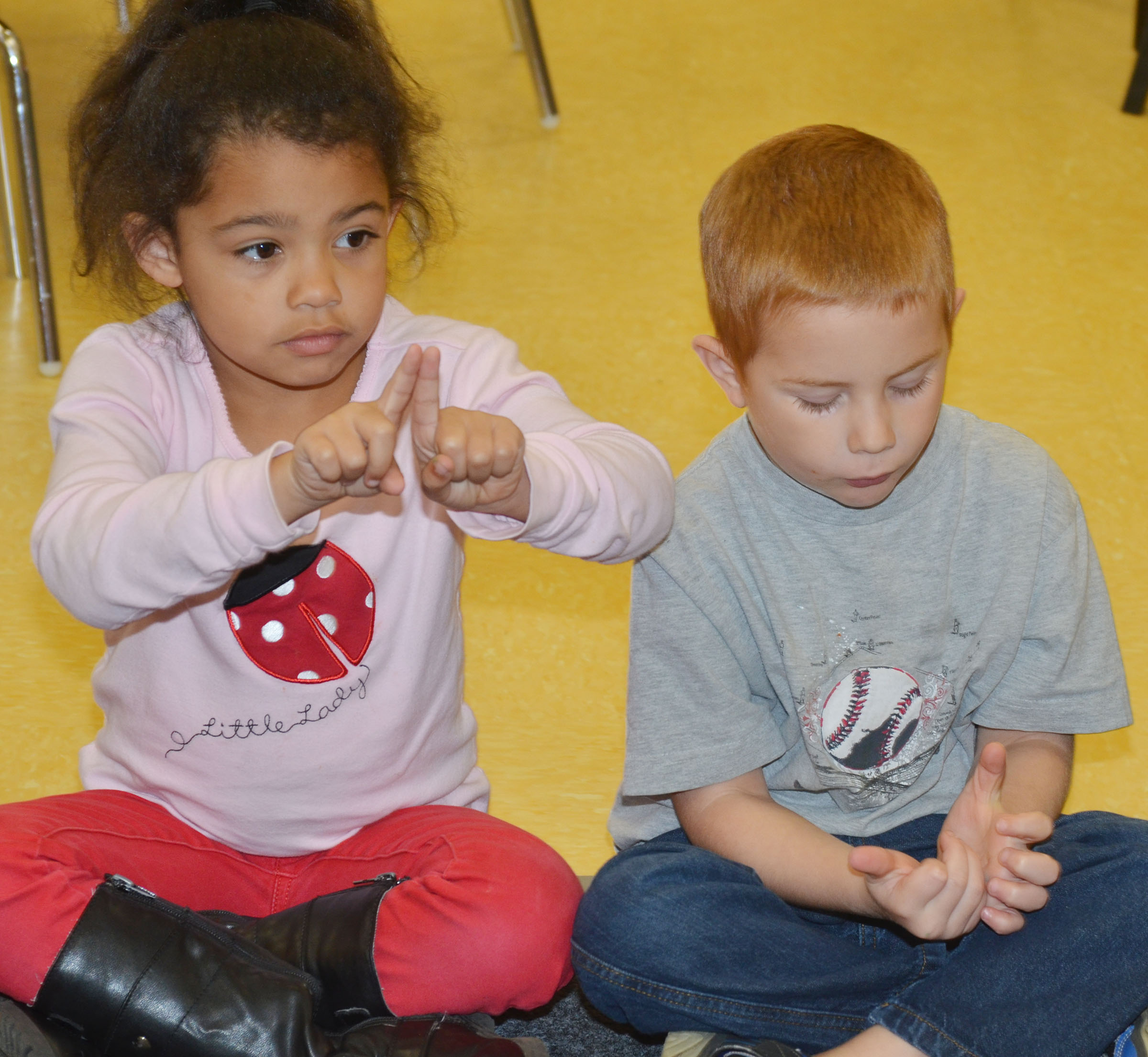 CES preschool student Rylee Karr, at left, and Kennon Dotson sing a song about counting.