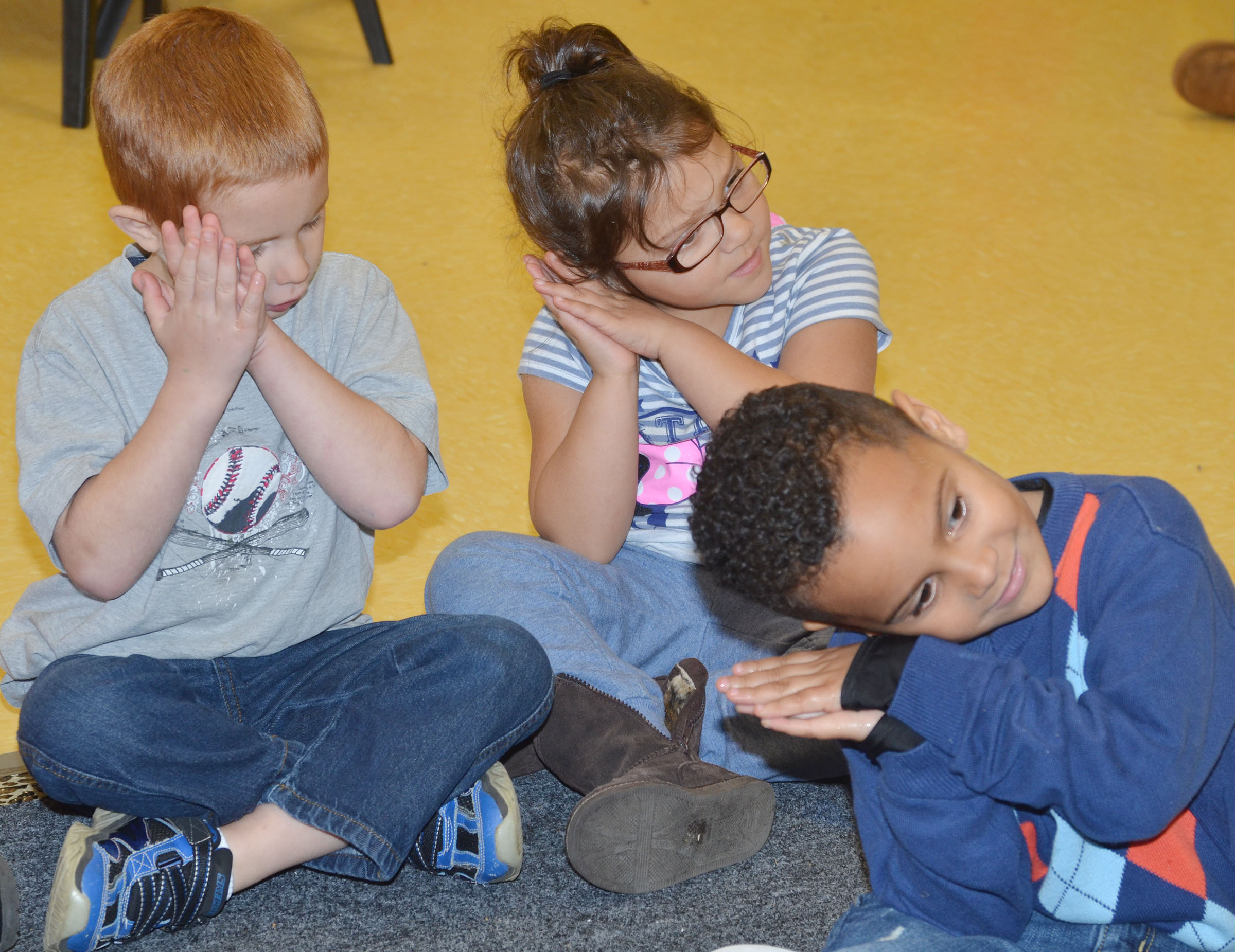 CES preschool students, from left, Kennon Dotson, Addisyn Taylor and Kingstown Cowherd sing a song about sleeping.