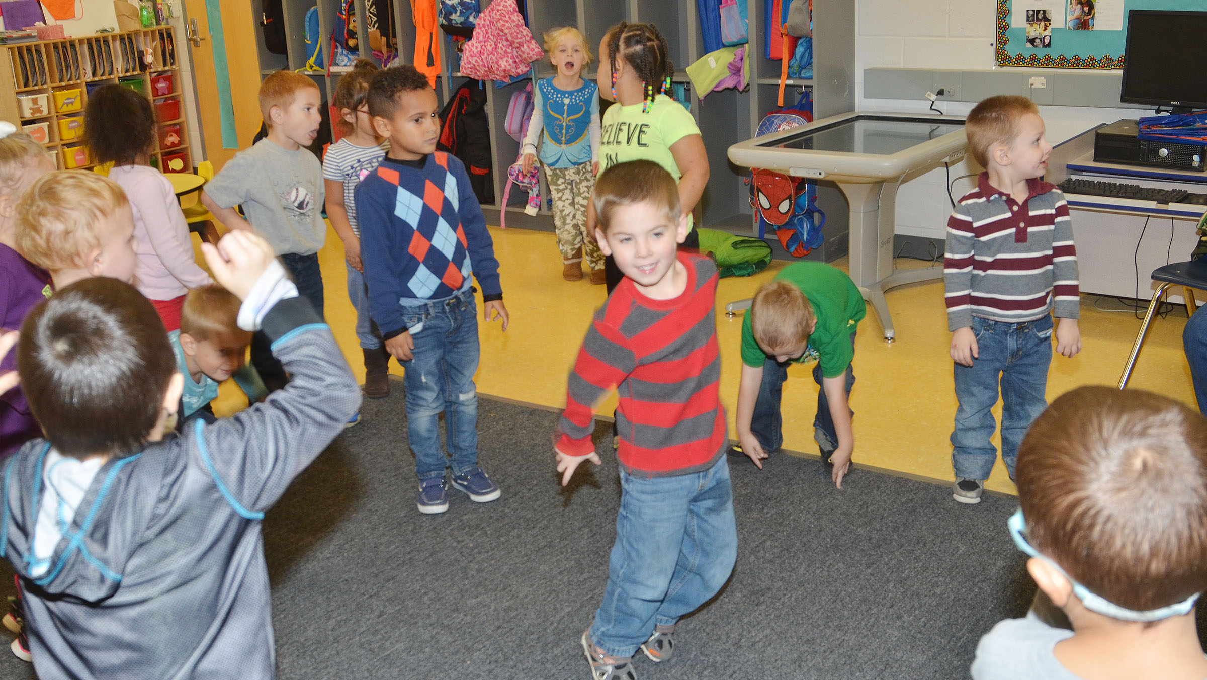 CES preschool students sing and dance together.