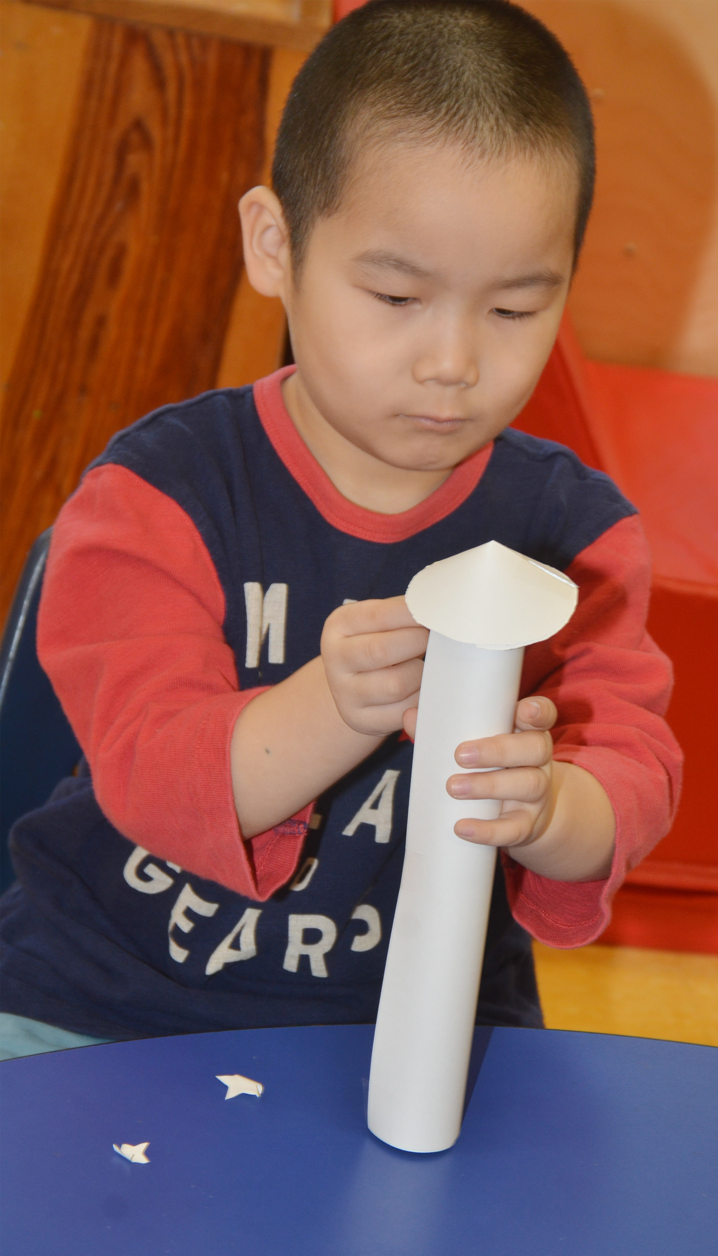 CES preschool student Calvin Yang decorates his rocket.
