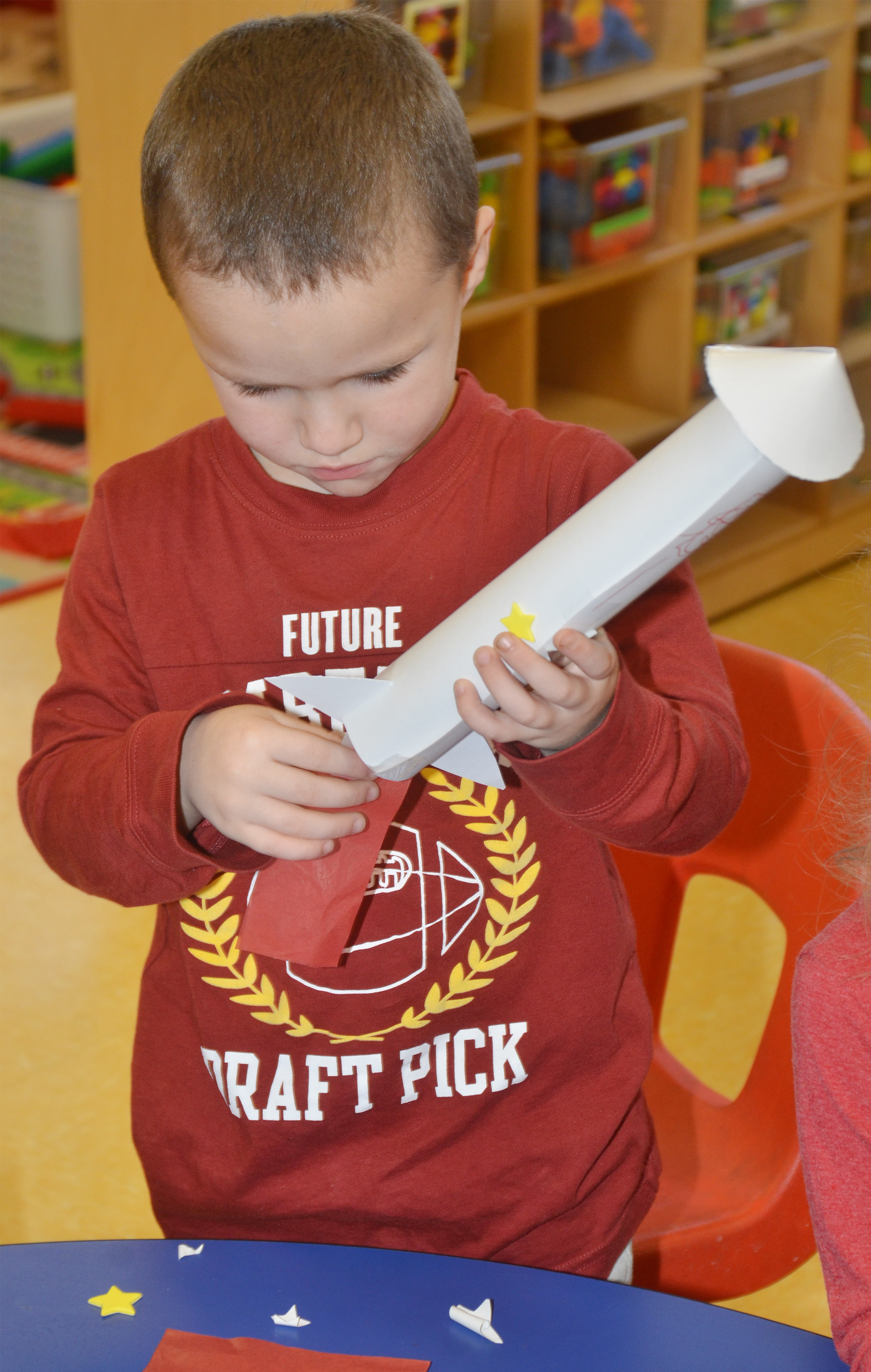CES preschool student Triton Bradshaw decorates his rocket.