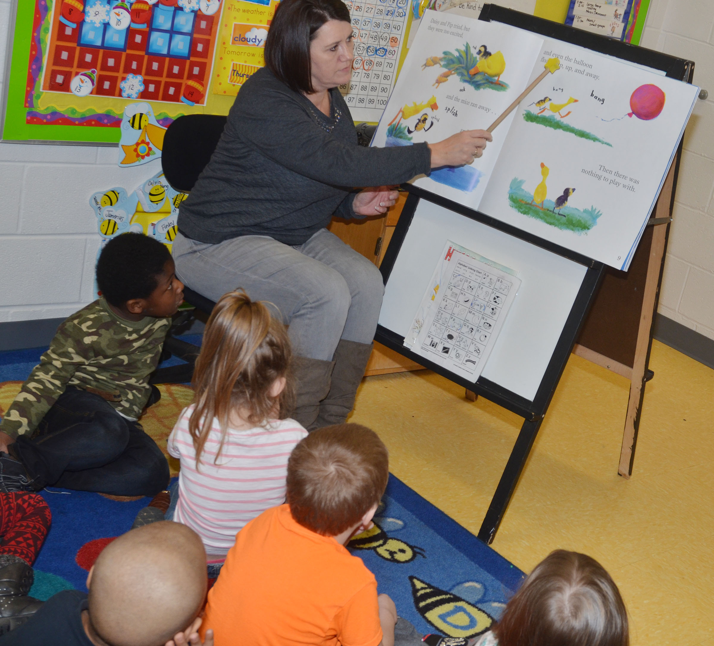 "CES preschool teacher Denise Spencer reads ""Quack, Daisy, Quack!"" with her students."