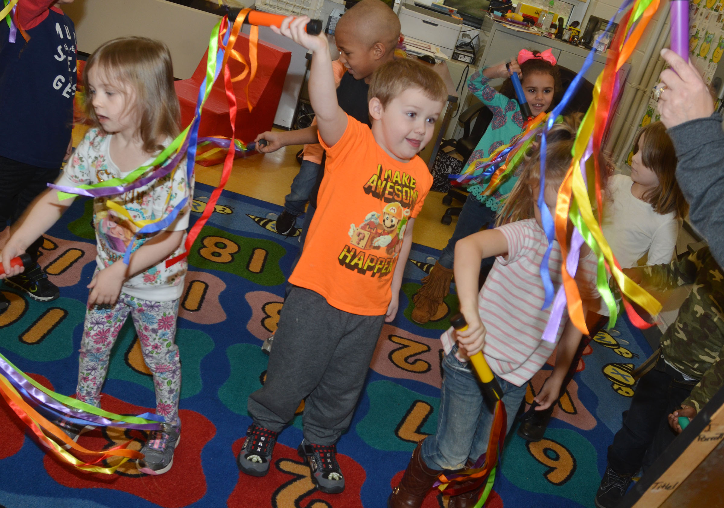 CES preschool student Levi Dye and his classmates dance with their ribbons.
