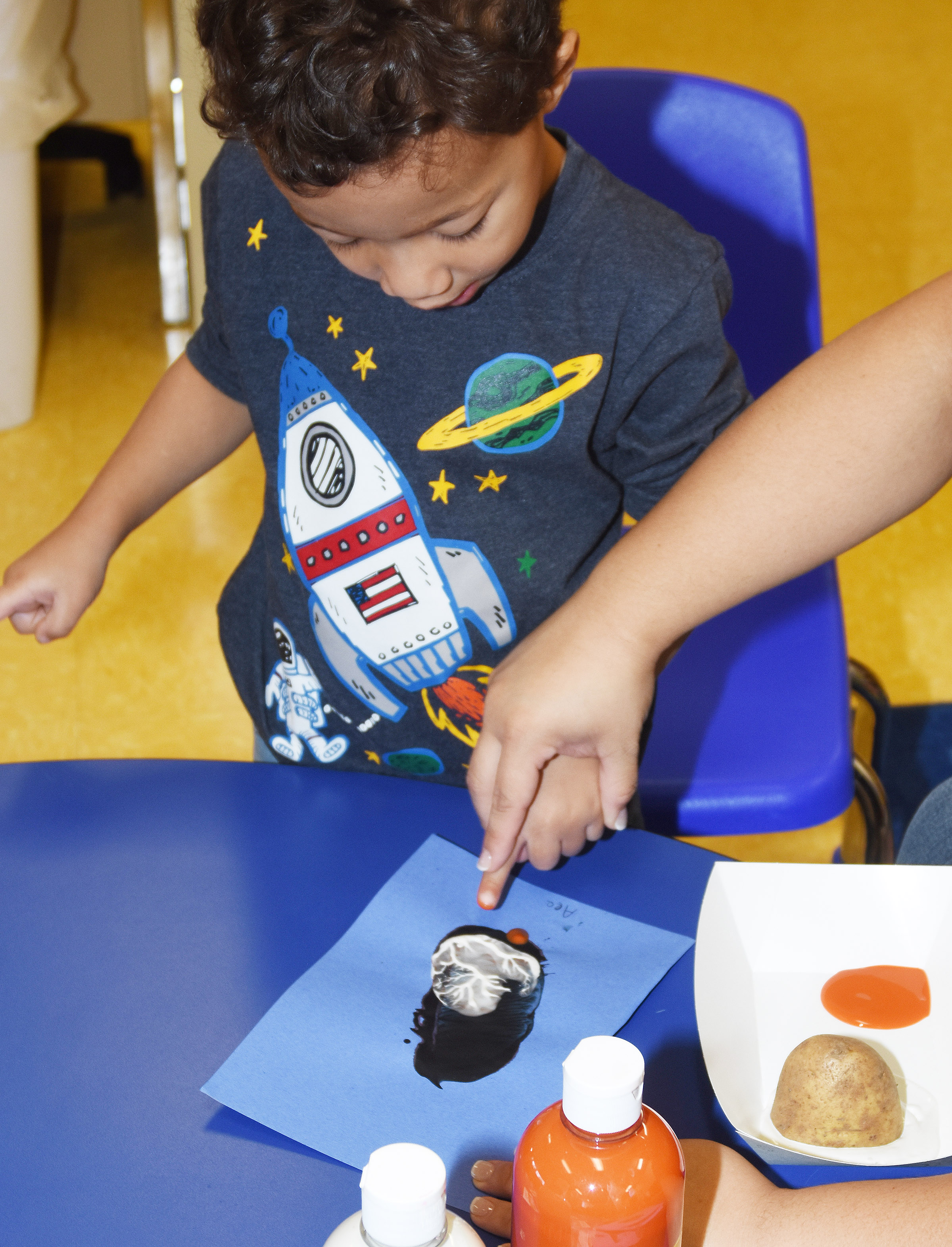 CES preschool student Ace Turner paints his penguin.