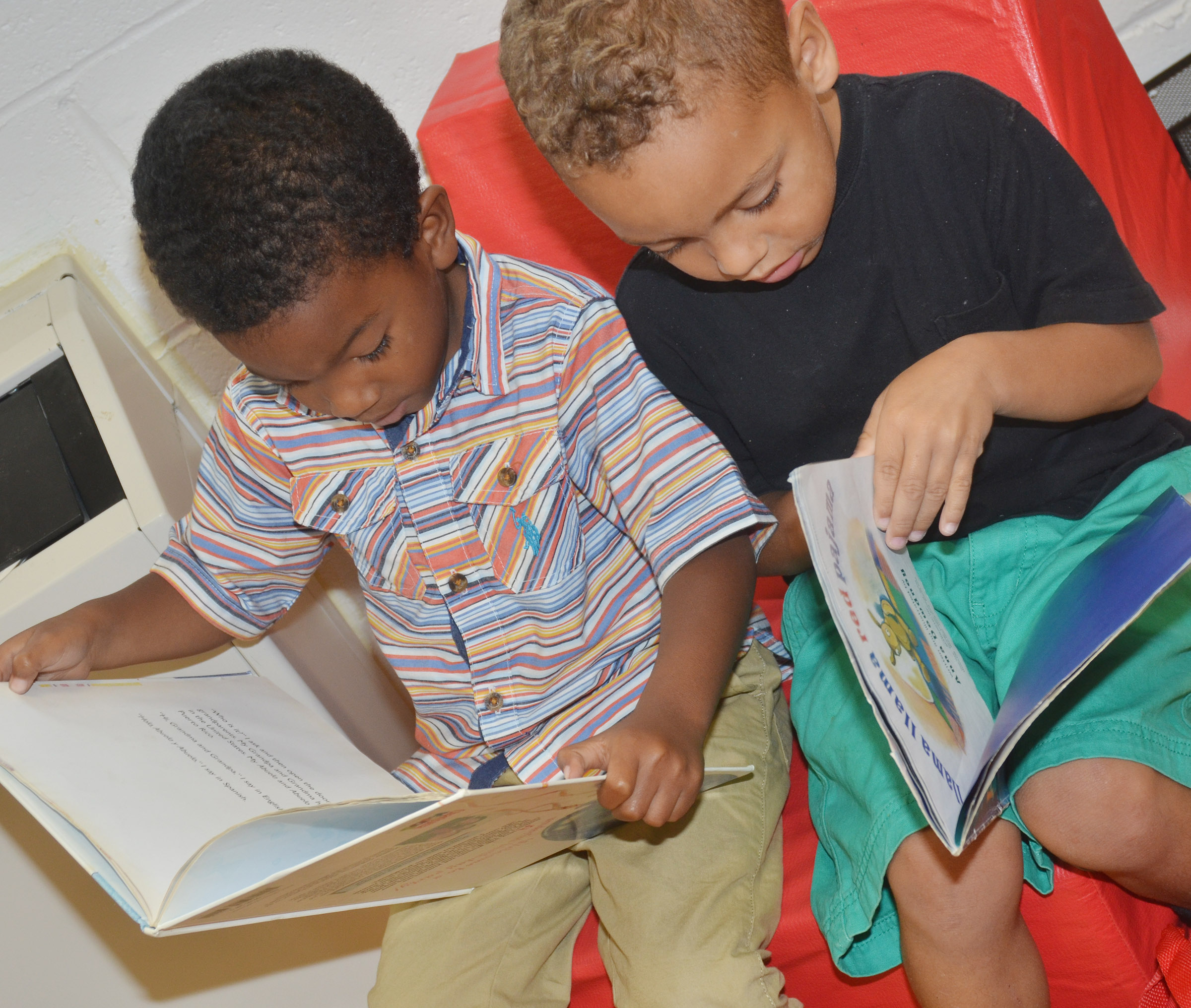 CES preschool students Rakim Dunn, at left, and Jasiahas Anderson read together.