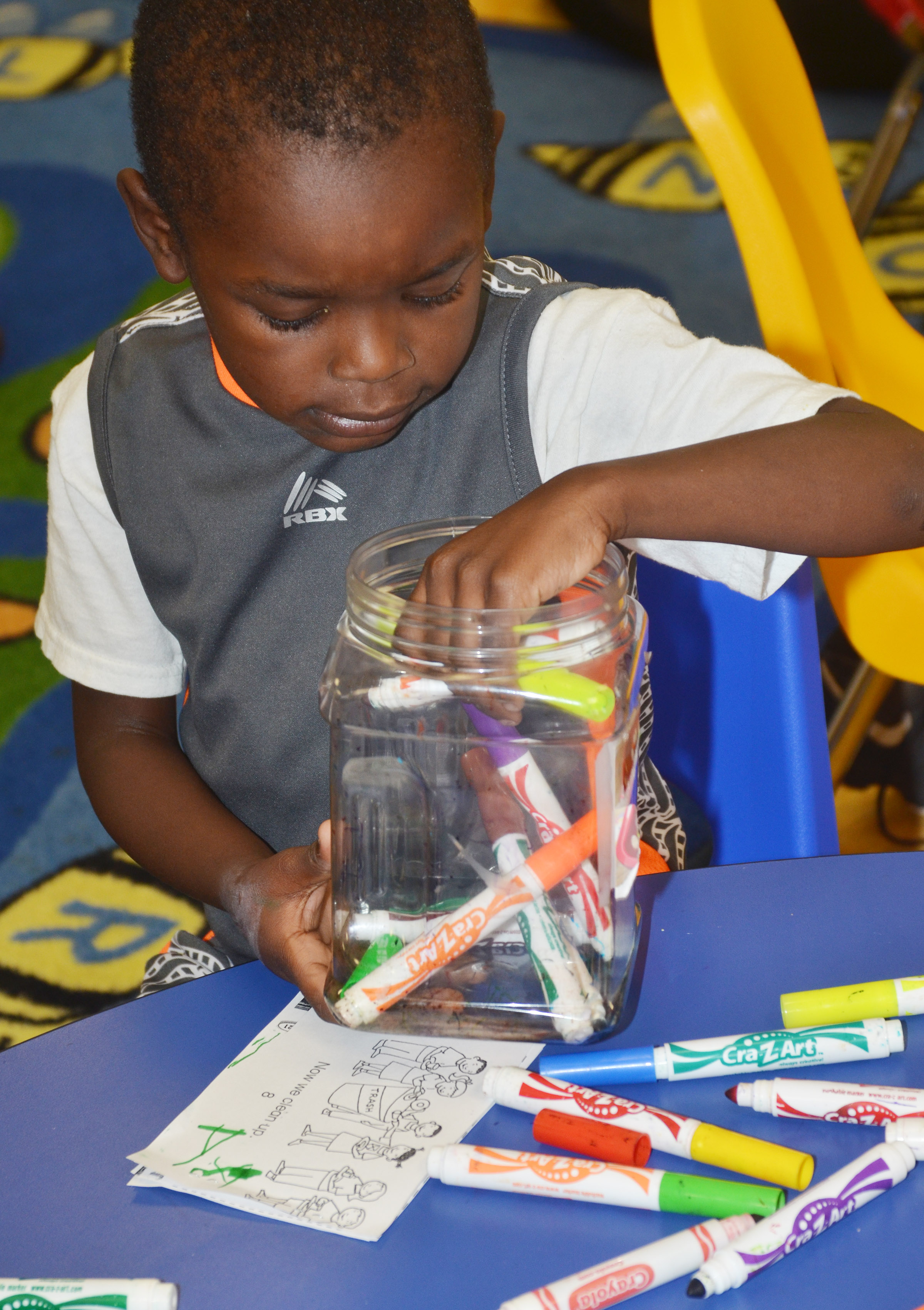 CES preschool student Xavien Smith tries to find his favorite color.