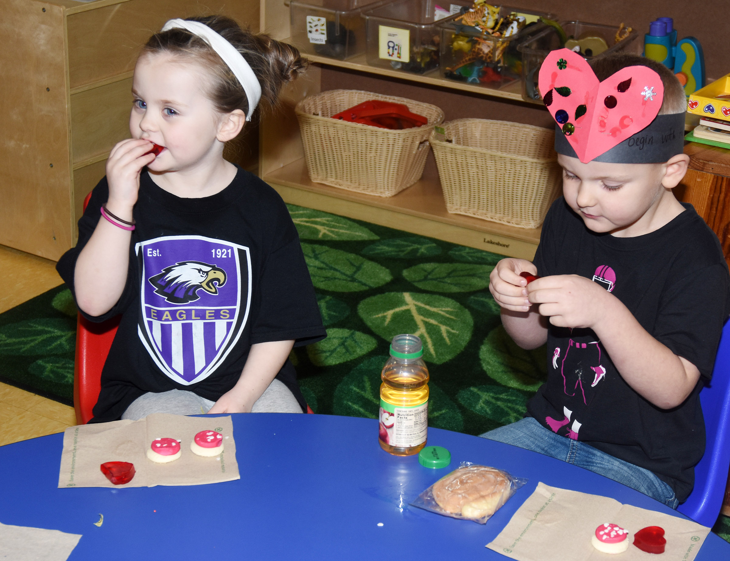 CES preschool students Tori Clark, at left, and Hoyt Davis enjoy Valentine snacks.